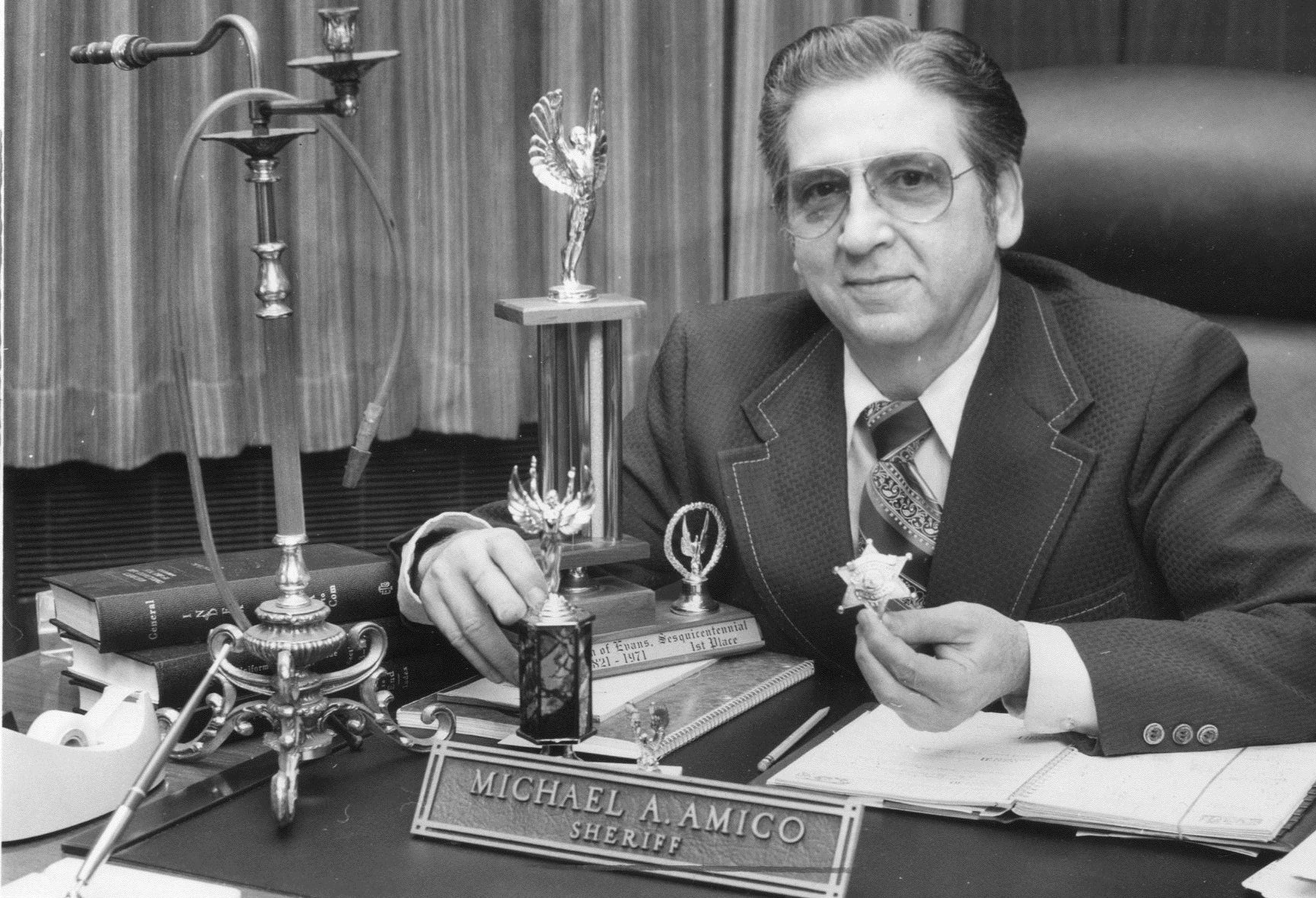 Then-Erie County Sheriff Michael A. Amico cleans out his desk and prepares to leave office in December 1976.