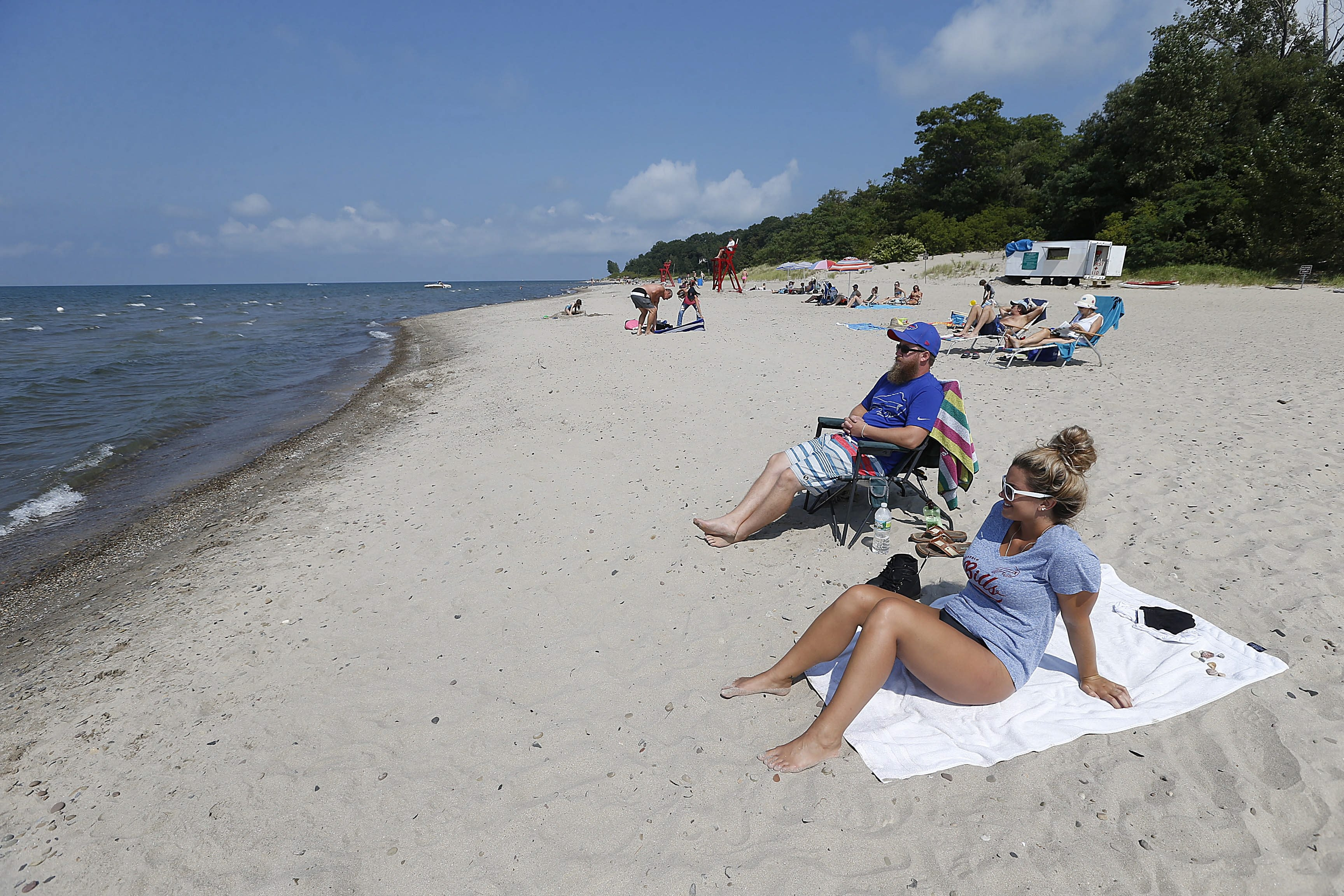Kevin Benedict and his wife, Katrina, of Ithaca, enjoy a day at Bennett Beach in Angola on Aug. 30. As of Friday, Bennett Beach had been closed to swimmers 41 days this summer.