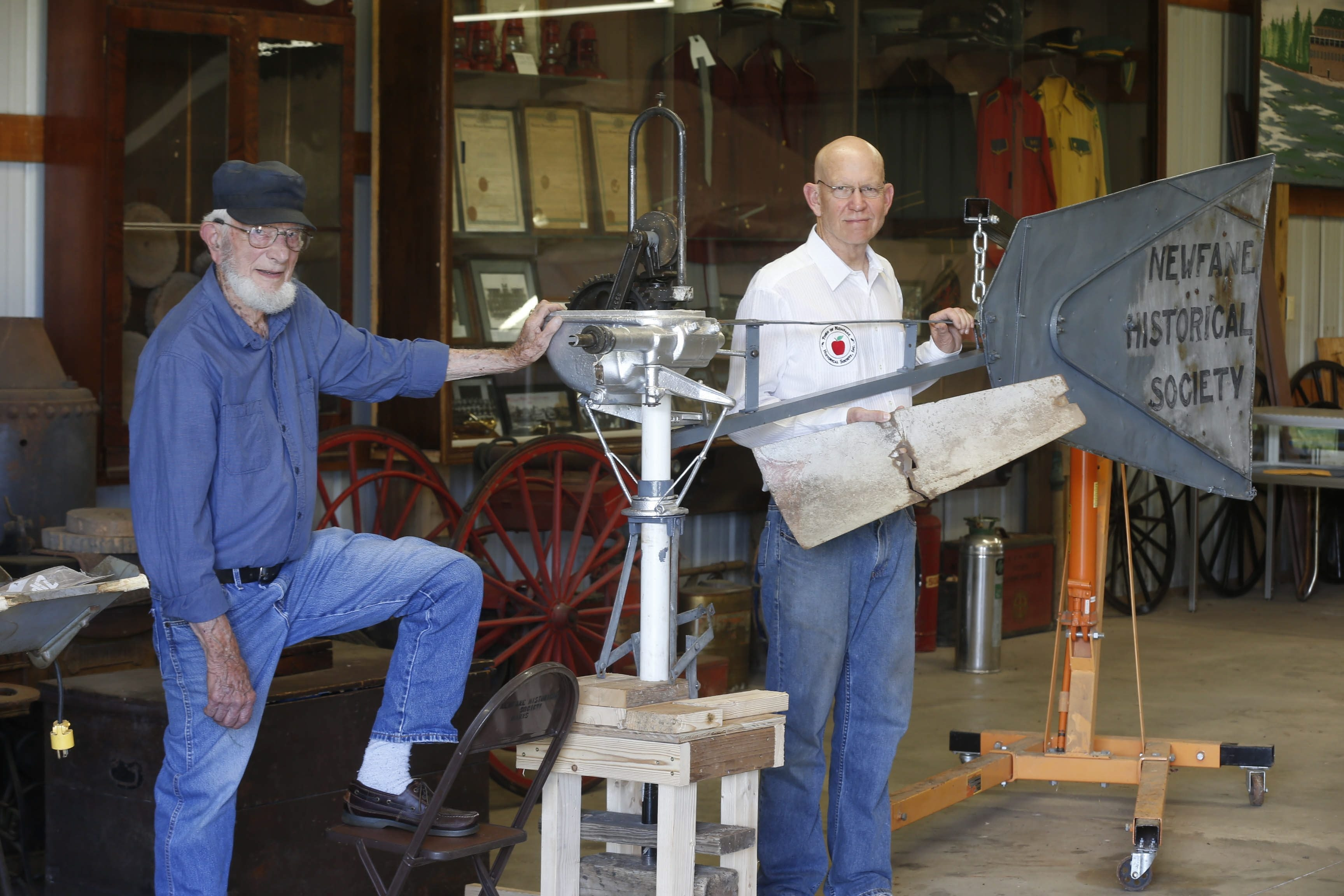 Sam Clogston, left, and Bill Neidlinger are in the process of restoring an old Aeromotor Water Pumping Windmill for the Newfane Historical Society. They have been working on the project off and on for almost a year.