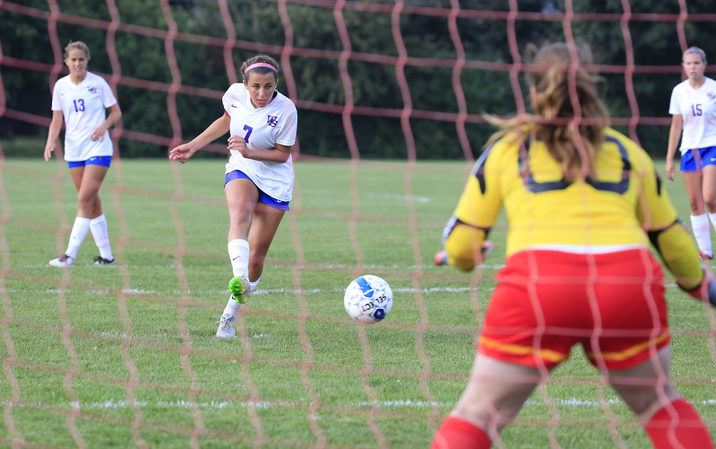 Williamsville South's Jamie Boyar scores on a penalty kick against Williamsville East goalkeeper Sara Penapento in Tuesday's game.