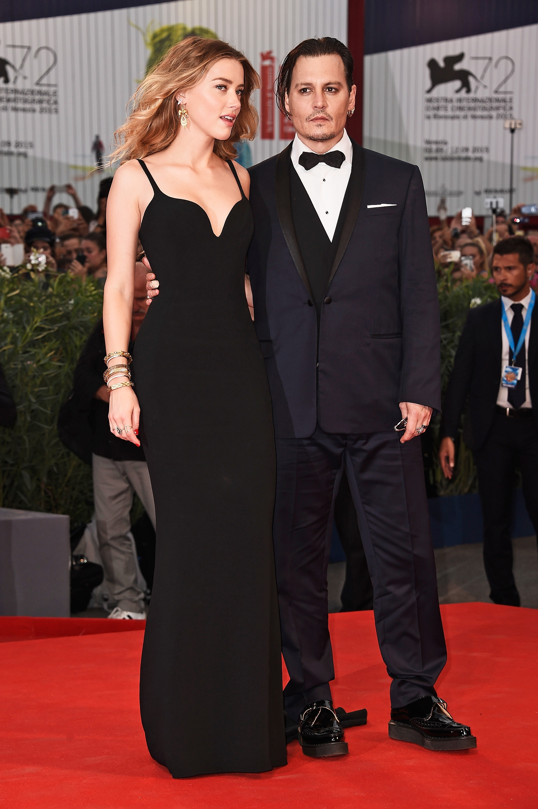 """Newlyweds Johnny Depp and Amber Heard made a rare public appearance at a premiere for """"Black Mass"""" Friday during the 72nd Venice Film Festival."""