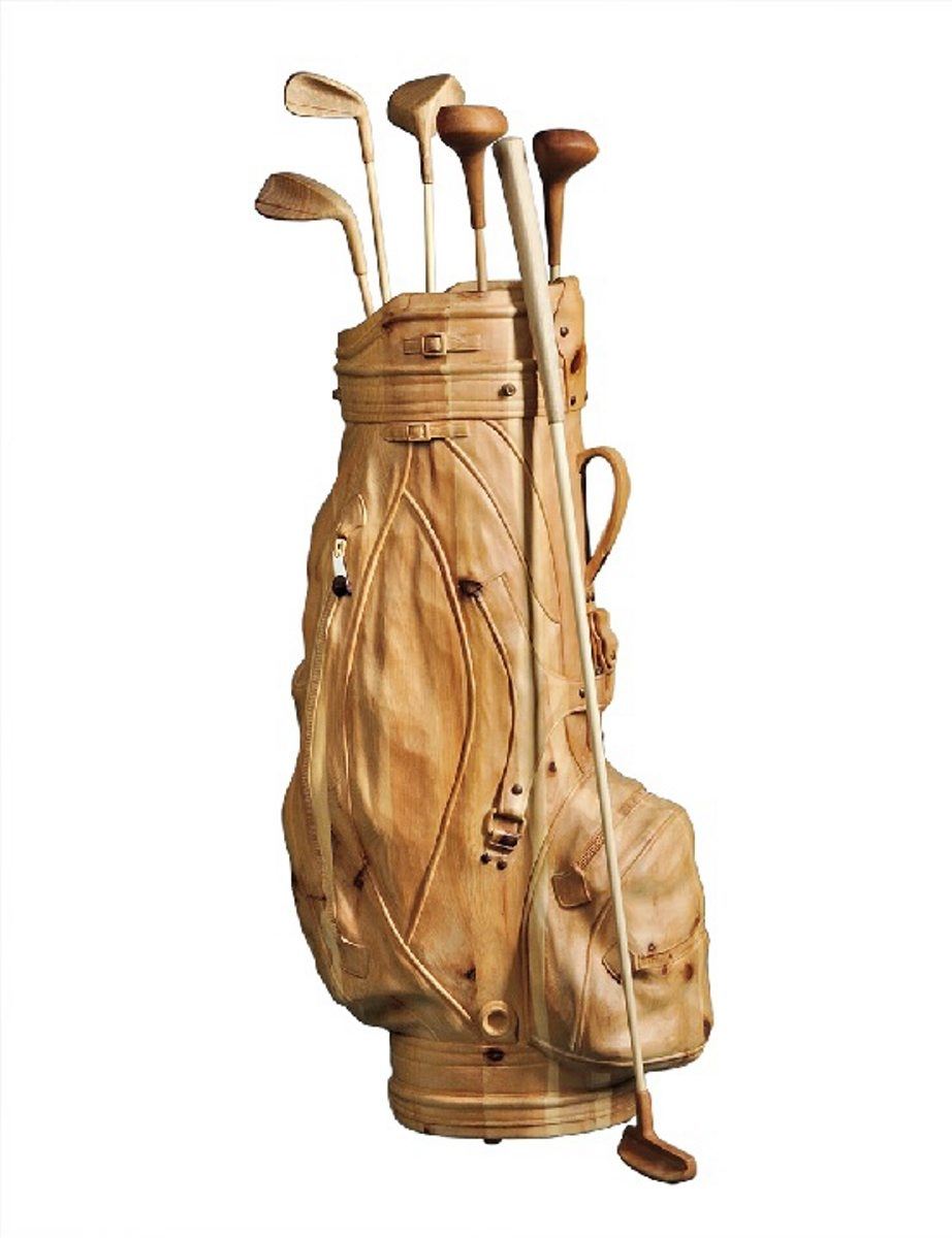 No, it's not a golf bag. It is a life-size unpainted wood sculpture by a contemporary Italian artist. It sold at a Skinner auction, Skinnerinc.com, in Boston for $3,240.