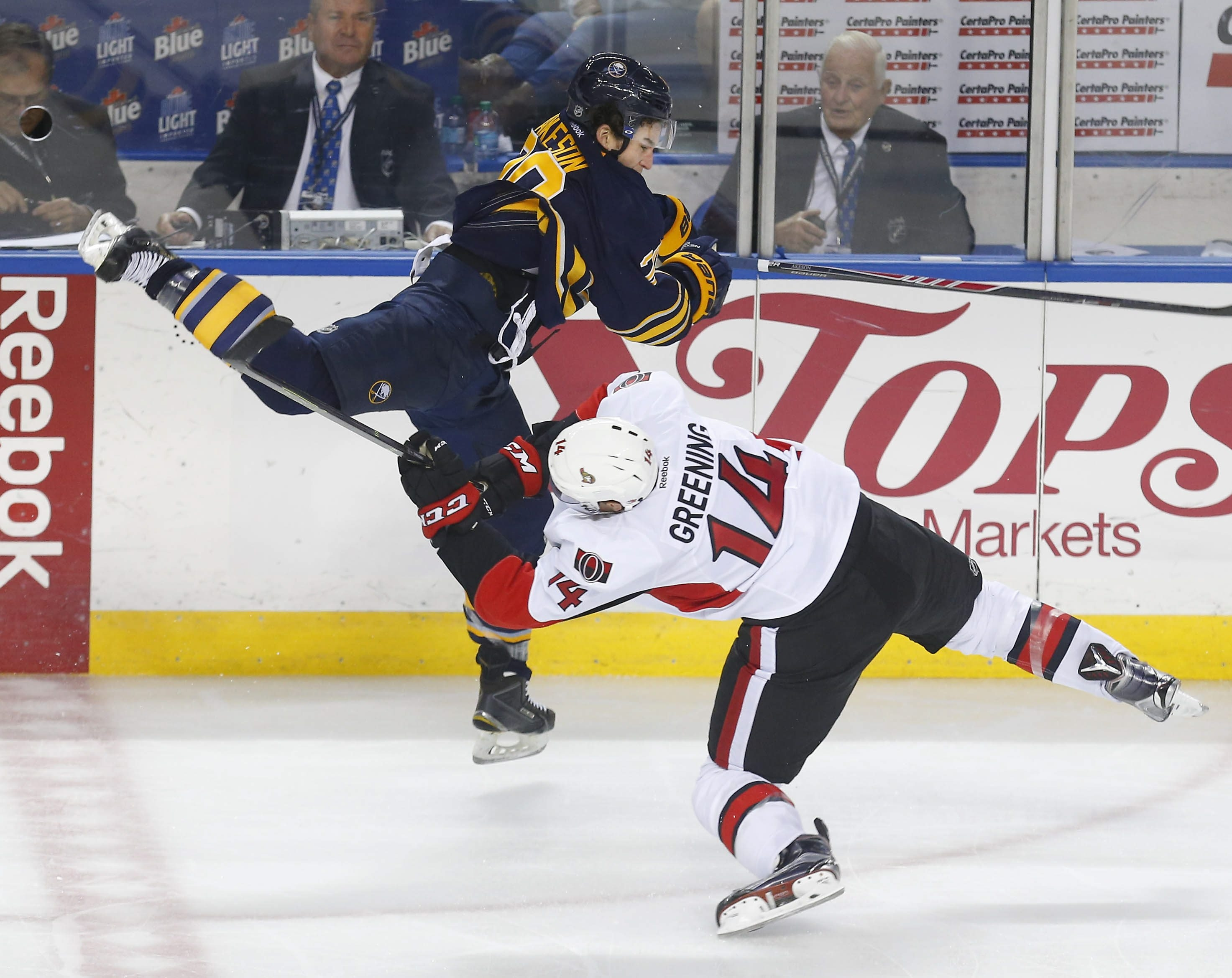 The Sabres' Jason Akeson puts a big hit on the Senators' Colin Greening during the third period of Wednesday's preseason game at First Niagara Center. (Mark Mulville/Buffalo News)
