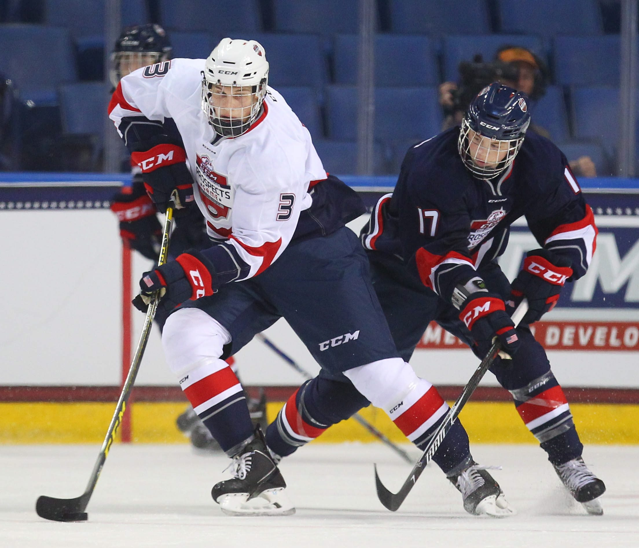 Team Roenick's Griffin Luce keeps the puck from Team Plante's Drake Rymsha during the second period of the CCM/USA Hockey All-American Prospects game at First Niagara Center in Buffalo Thursday, September 24, 2015.     (Mark Mulville/Buffalo News)