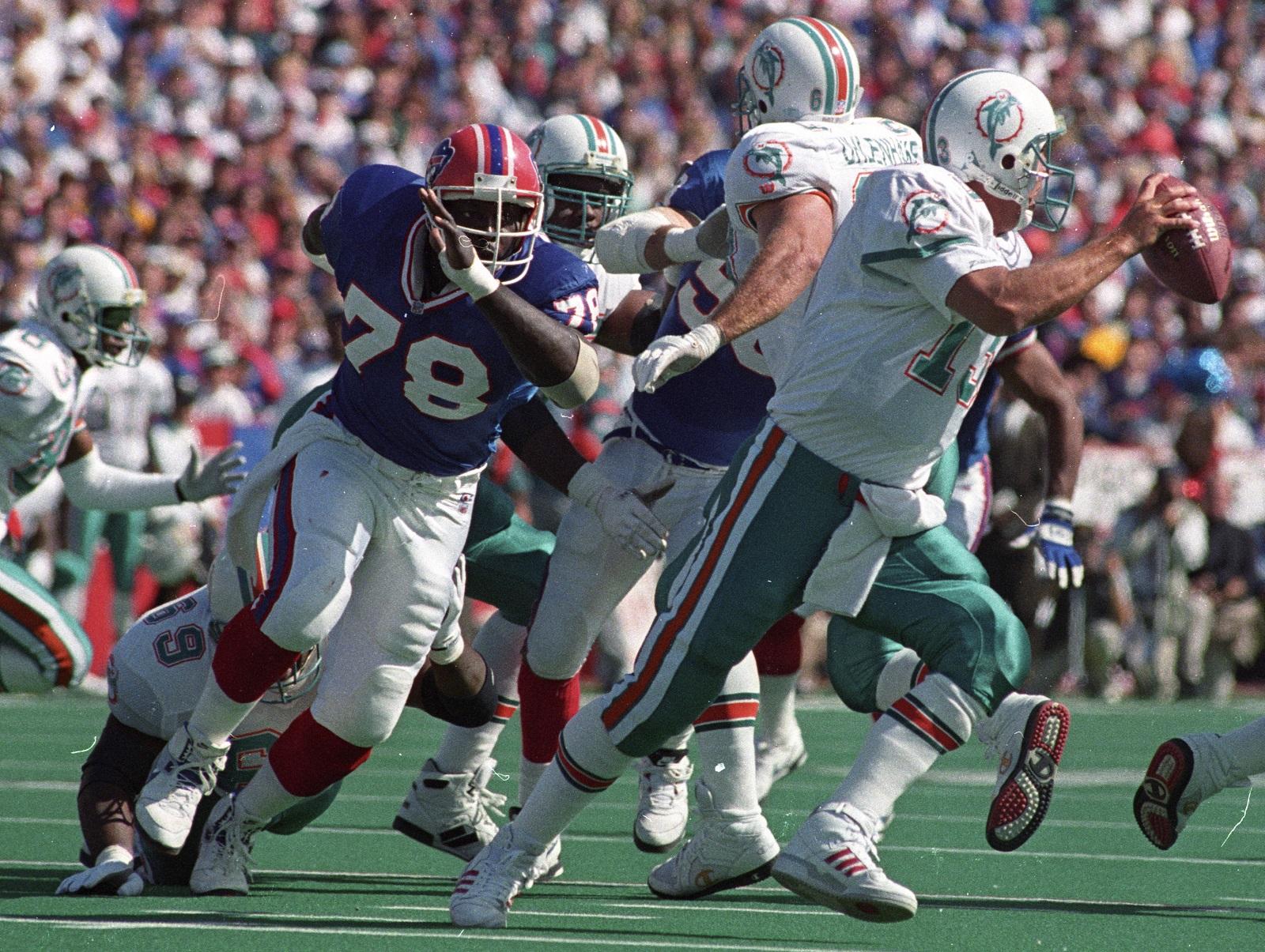 Buffalo Bills defensive end Bruce Smith pursues Dolphins quarterback Dan Marino. (Buffalo News file photo)