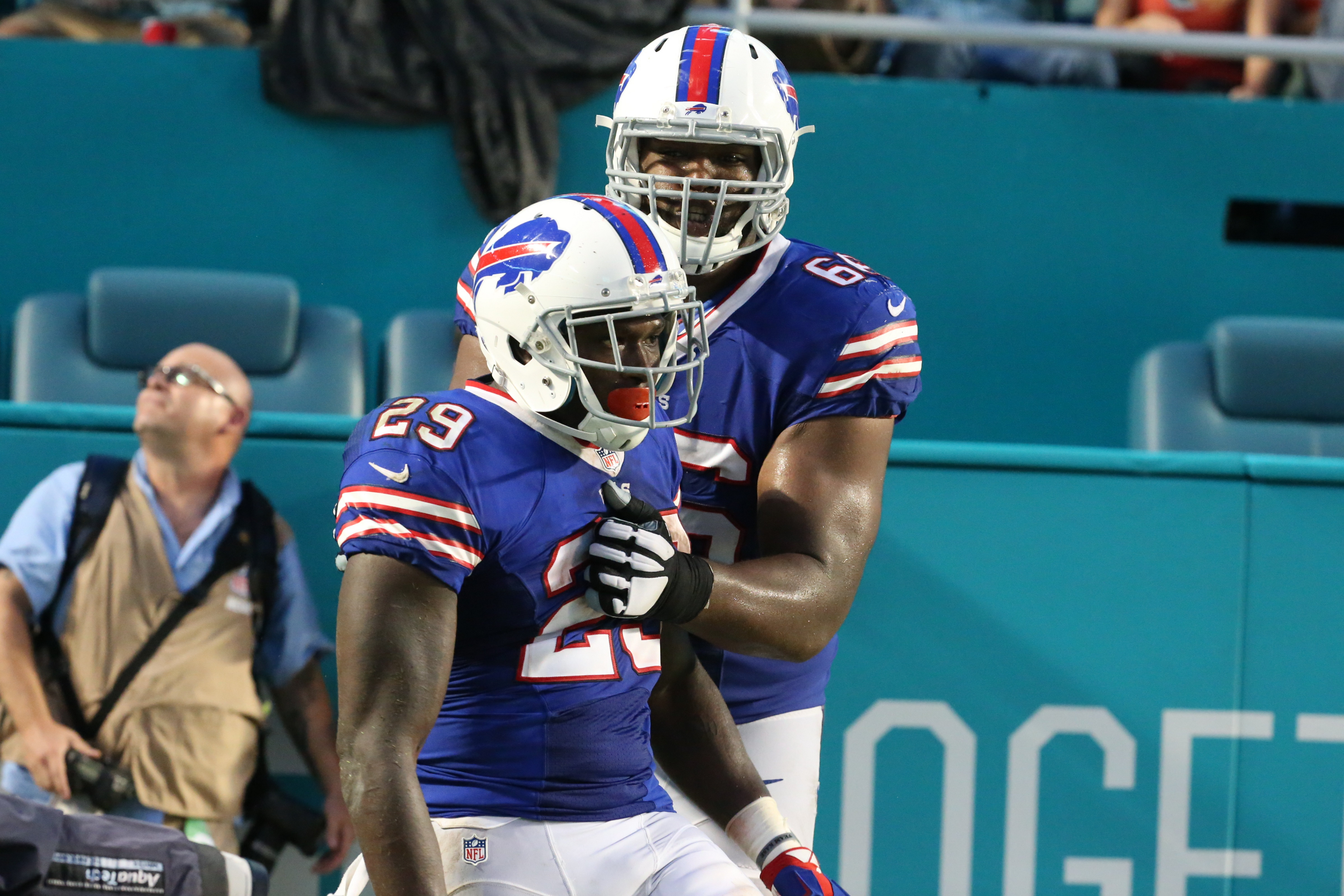 Buffalo Bills running back Karlos Williams (29) celebrates after his 41-yard fourth-quarter touchdown in the Bills' first meeting against the Dolphins. (James P. McCoy/ Buffalo News)