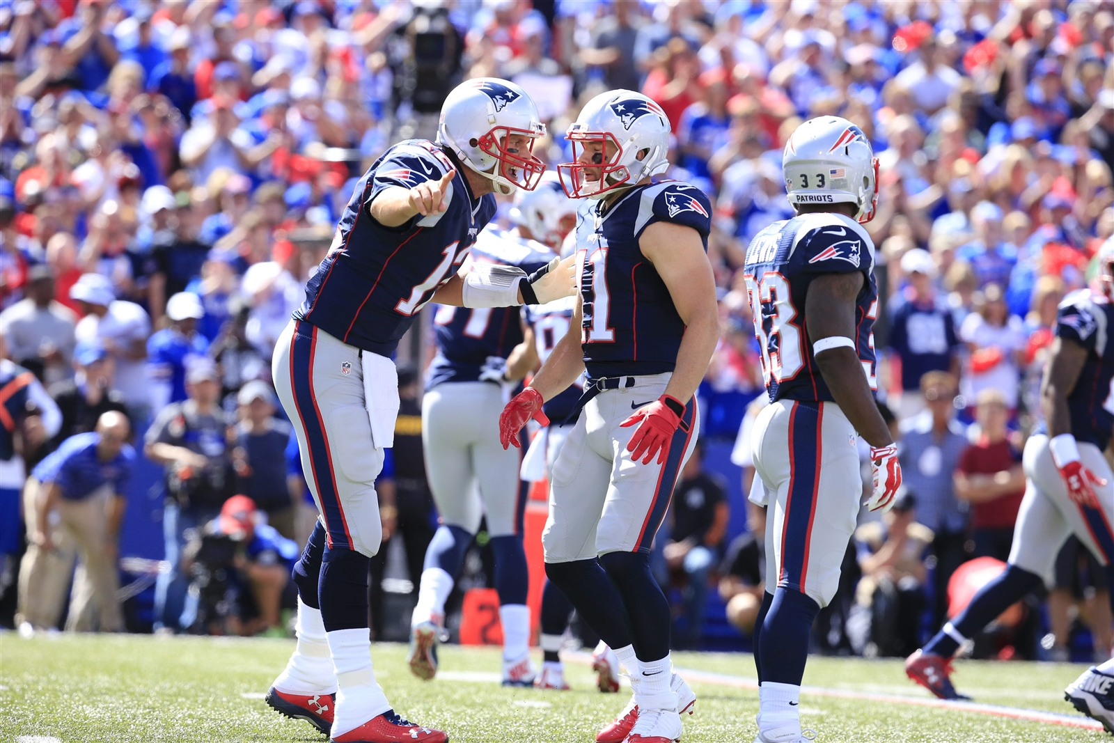 Tom Brady makes a strong point to Julian Edelman in the first quarter. (Harry Scull Jr./Buffalo News)