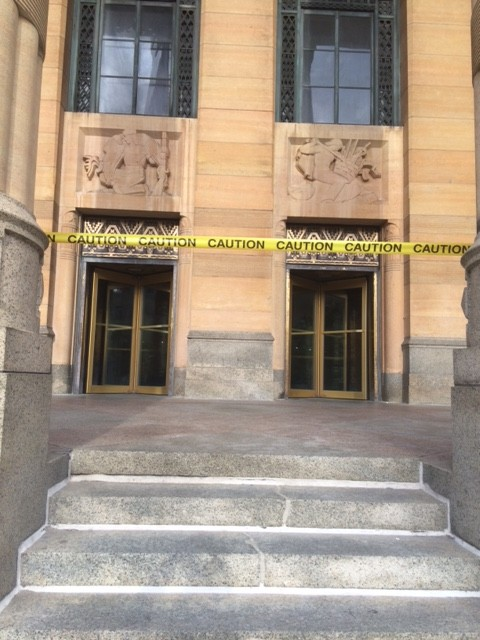 Buffalo City Hall front entrance temporarily close while stone art work being cleaned.  Side and back entrances to building are open.