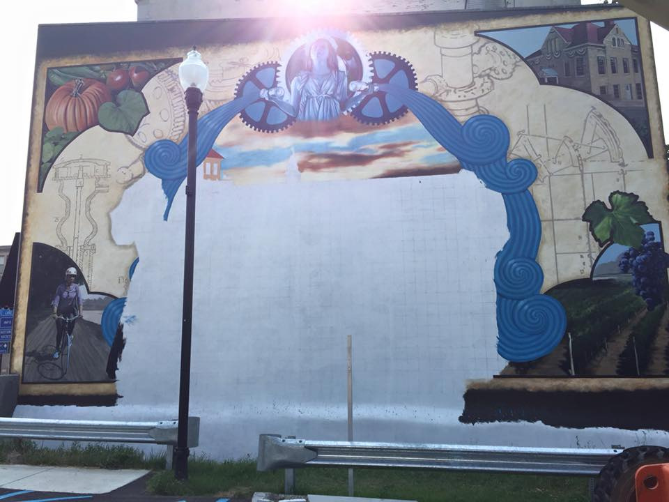 A new mural honoring Lockport's culture and history is in progress on the side of 51 Main St.