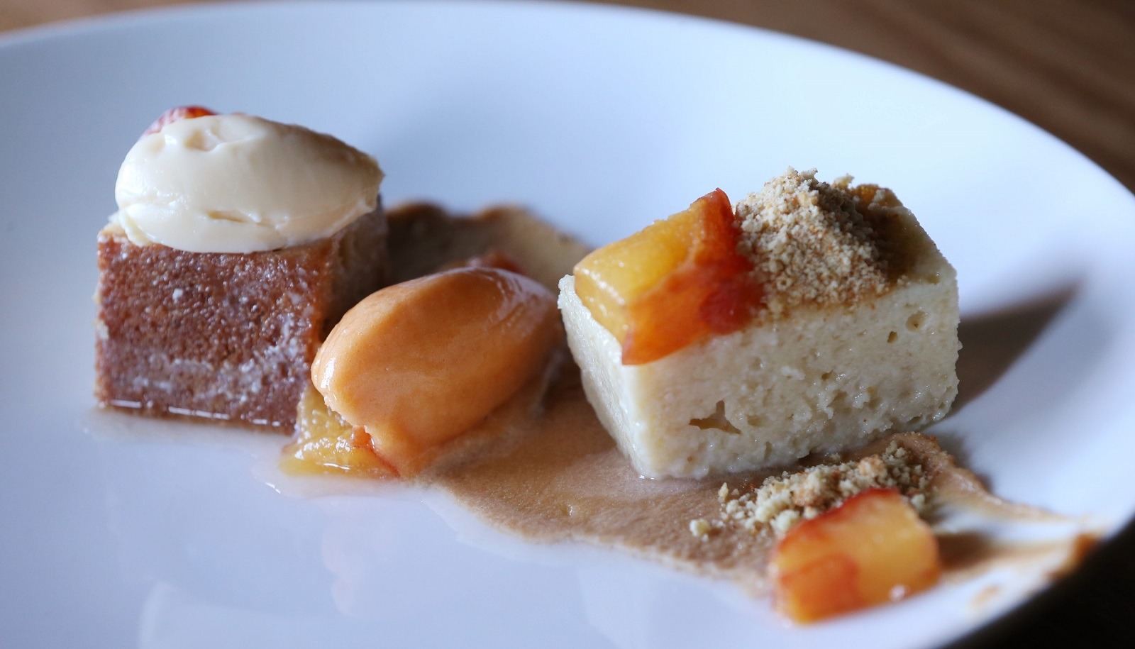 Toutant's Purty Fancy dessert is peach cake, apricot sorbet, dulce de leche and white chocolate ganache. (Sharon Cantillon/Buffalo News)