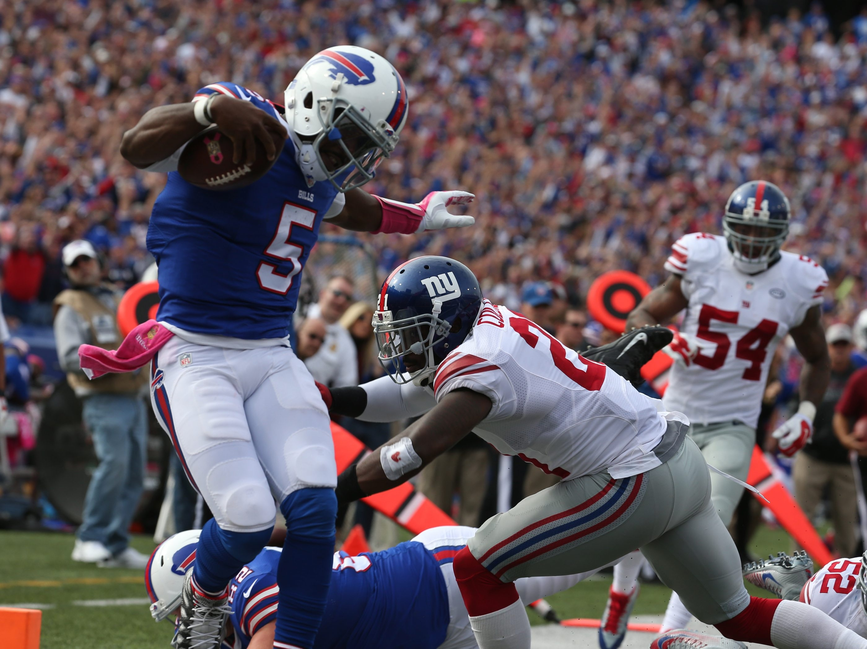 Buffalo Bills quarterback Tyrod Taylor (5) rushed for a touchdown but was called back on a penally in the third quarter at Ralph Wilson Stadium in Orchard Park,NY on Sunday, Oct. 4, 2015.  (James P. McCoy/ Buffalo News)