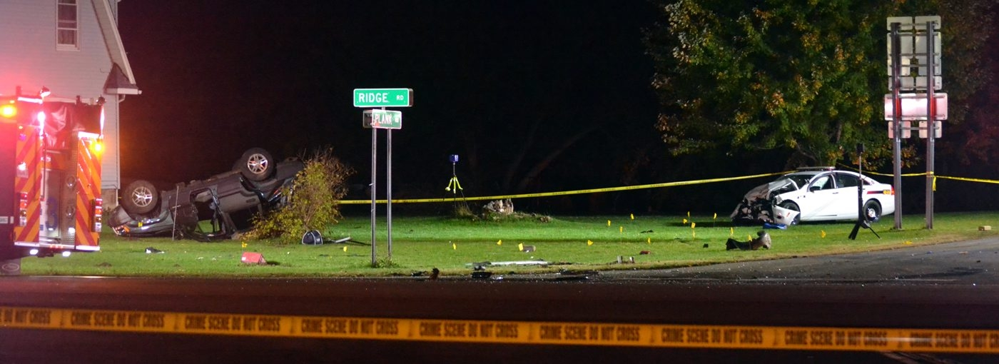 Police tape marks the scene of Thursday night's accident on Ridge Road in Cambria, where  a Niagara County deputy's patrol car collided with a Jeep, killing the Jeep's driver and injuring his passenger .