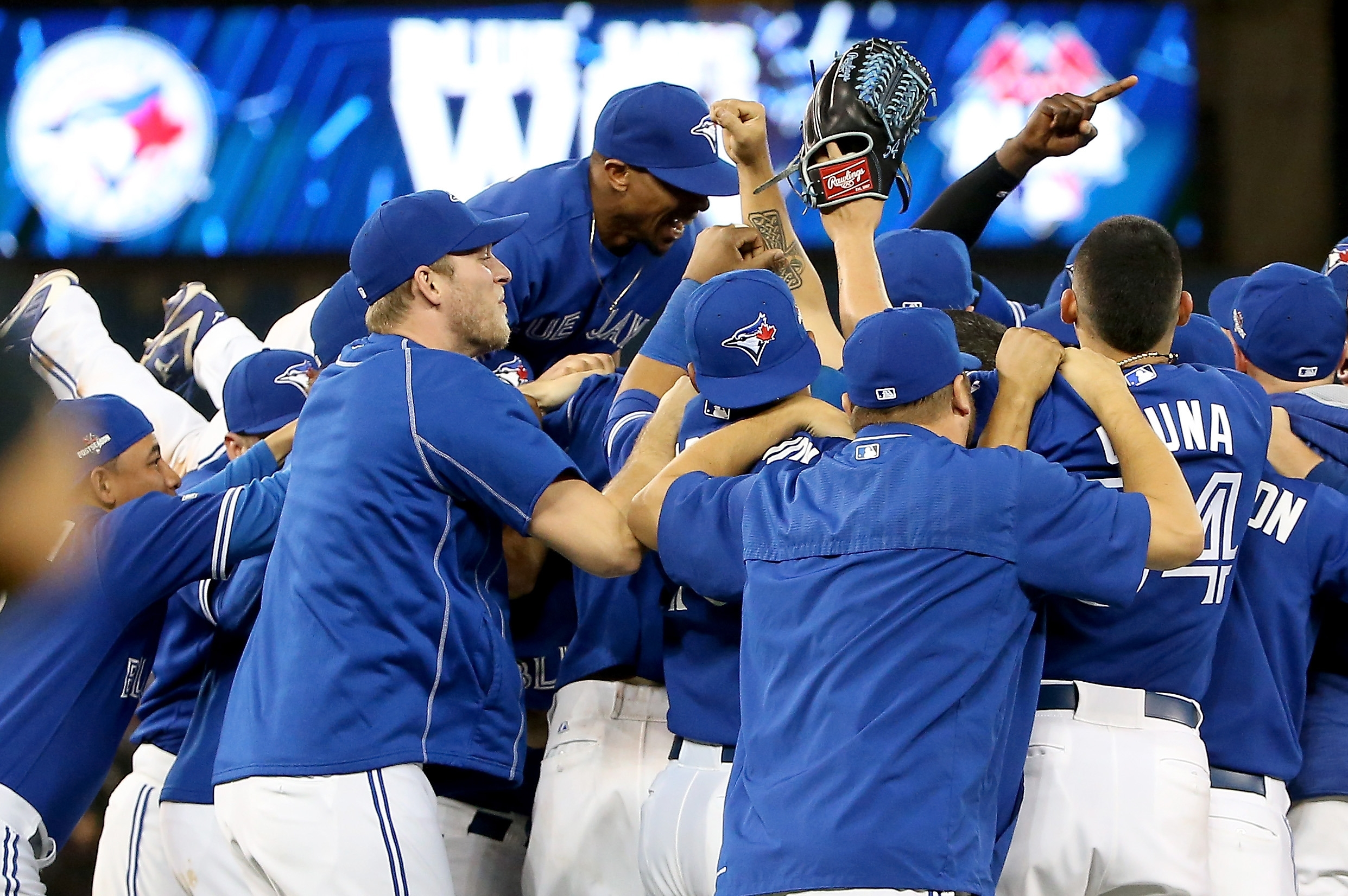 The Toronto Blue Jays celebrate after defeating Texas, 6-3, in Game Five of the American League Division Series.
