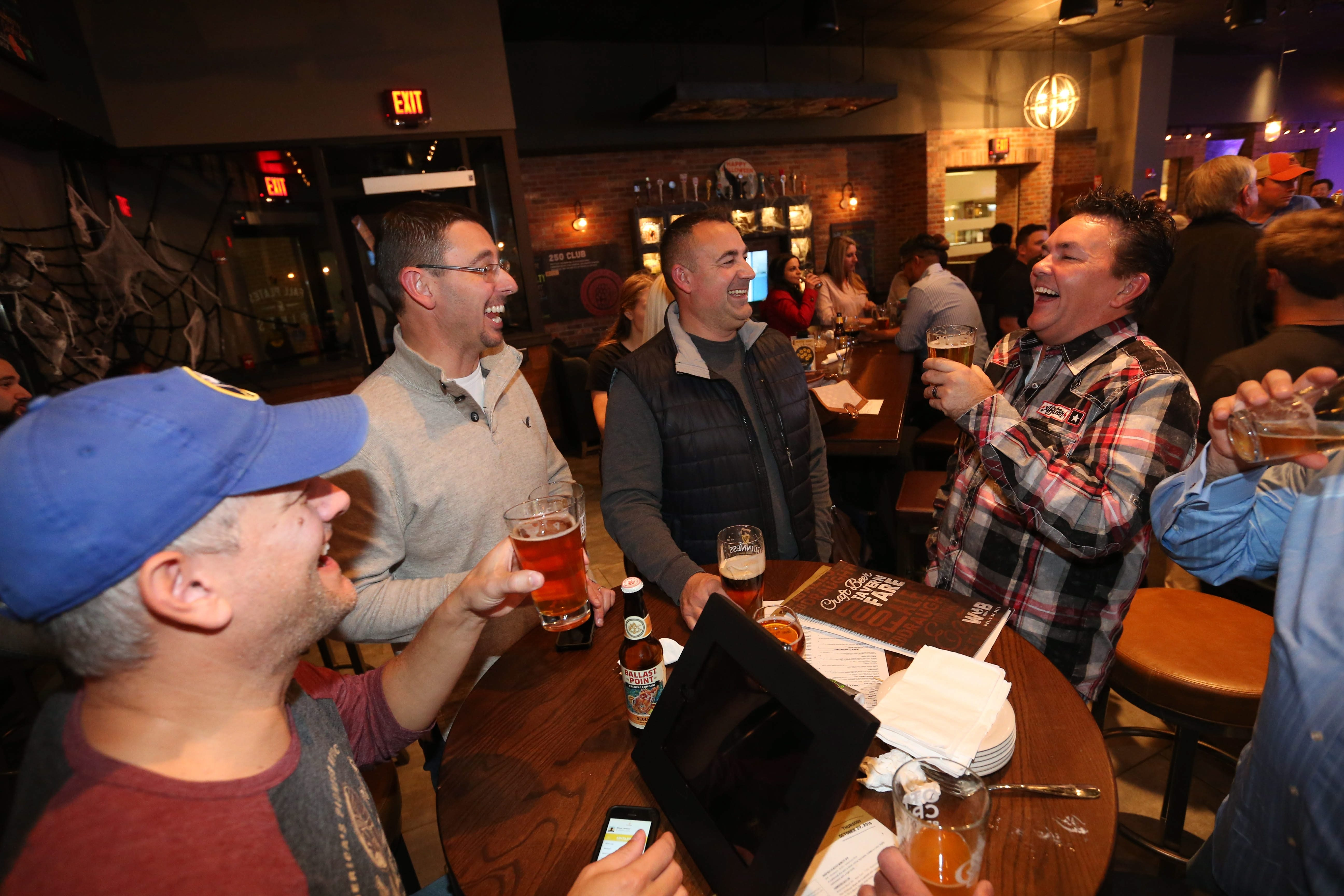 World of Beer is a fun new drinking spot in the Walden Galleria. Steve Jensen, left, Tim Cramer, Tim Pickering and Brian Chapin get in the spirit of the season.