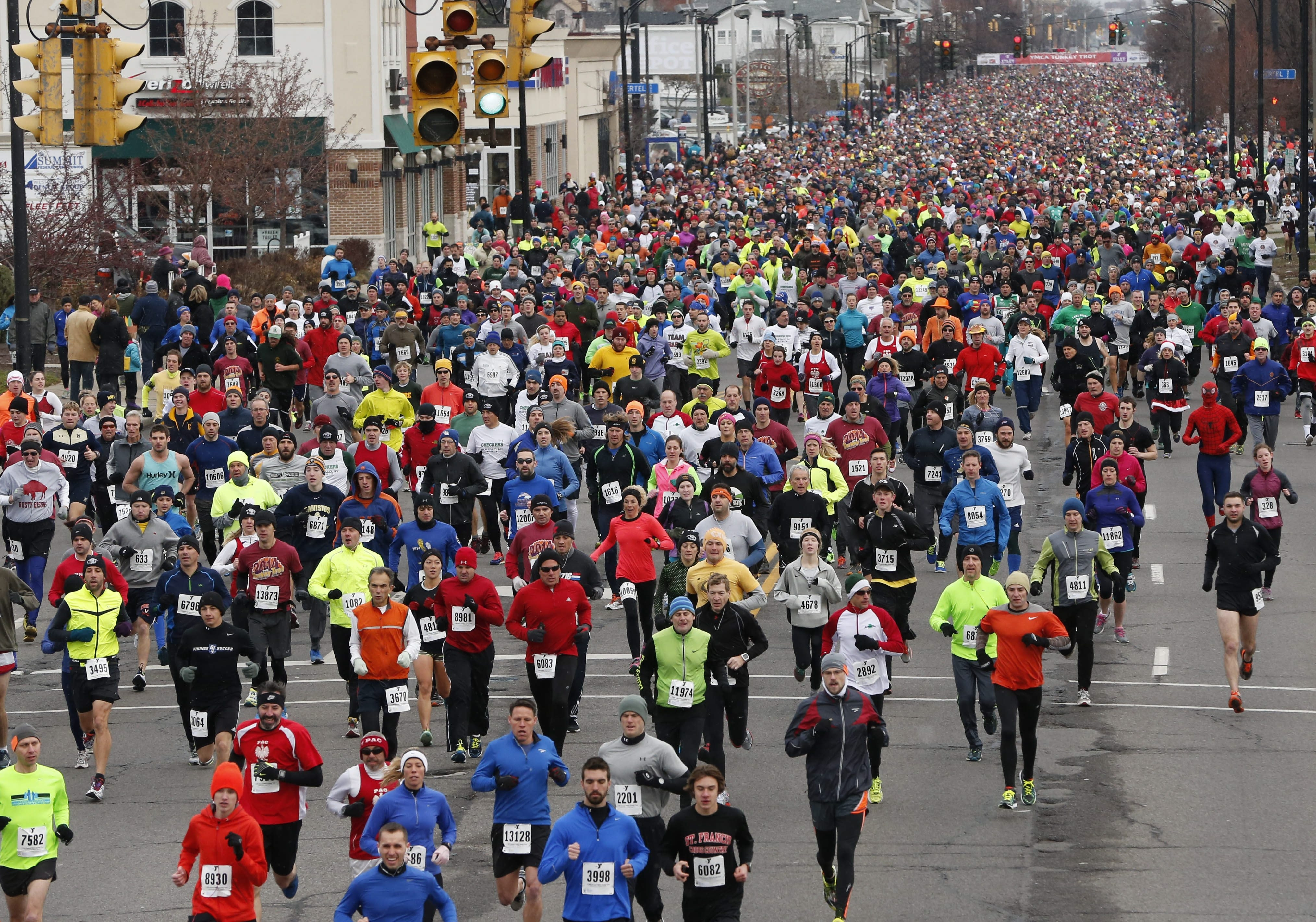 Runners leave the starting line on Delaware Avenue for the 119th annual YMCA Turkey Trot, Thursday, Nov. 27, 2014.  (Derek Gee/Buffalo News)