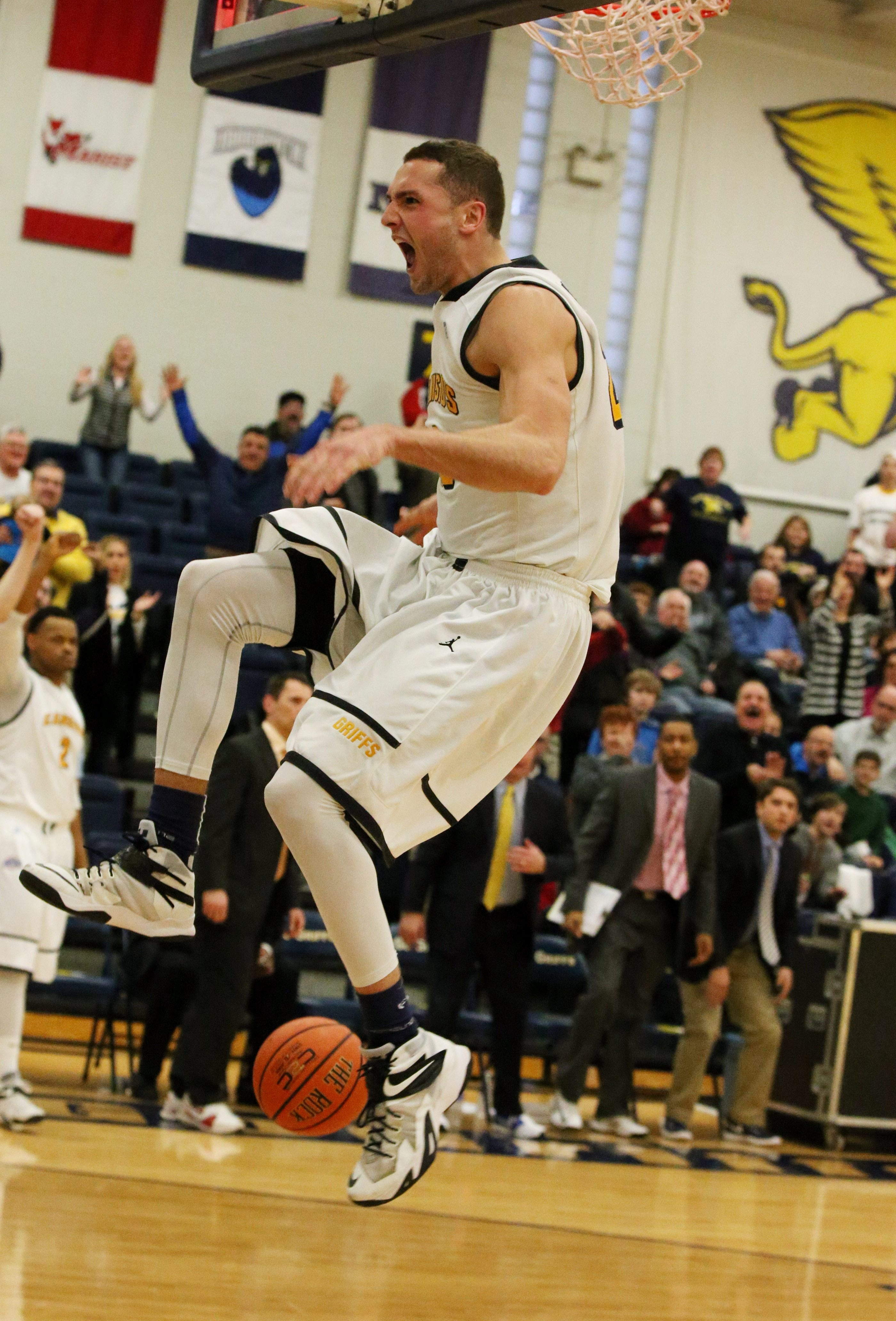 """Phil Valenti exults in a dunk in the final seconds against Iona last year. He's a leader of Jim Baron's pack of """"junkyard dogs."""""""