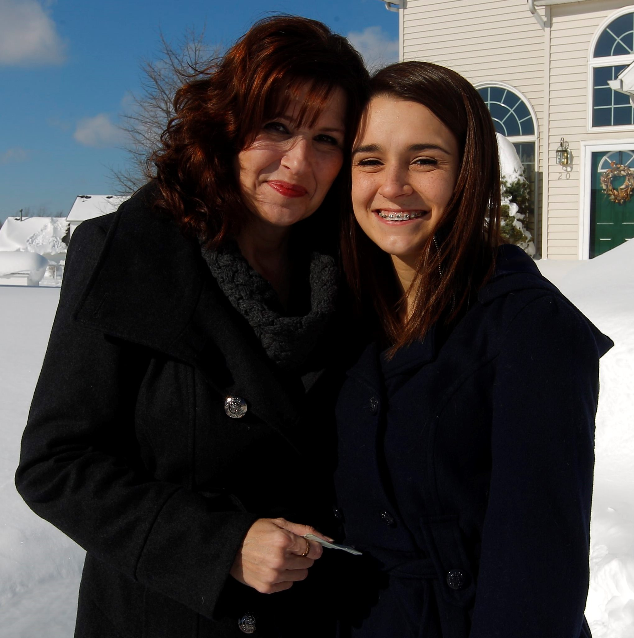 Days after being trapped in her snow-buried car, Karen Rossi posed for a photo with her daughter Madelyn. (John Hickey/Buffalo News file photo)