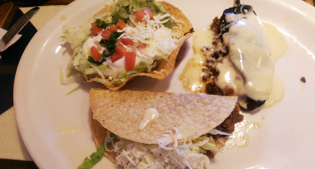 The chile relleno, top right, is the standout of the grande especial at Springville's Fiesta Bamba. (The Buffalo News)