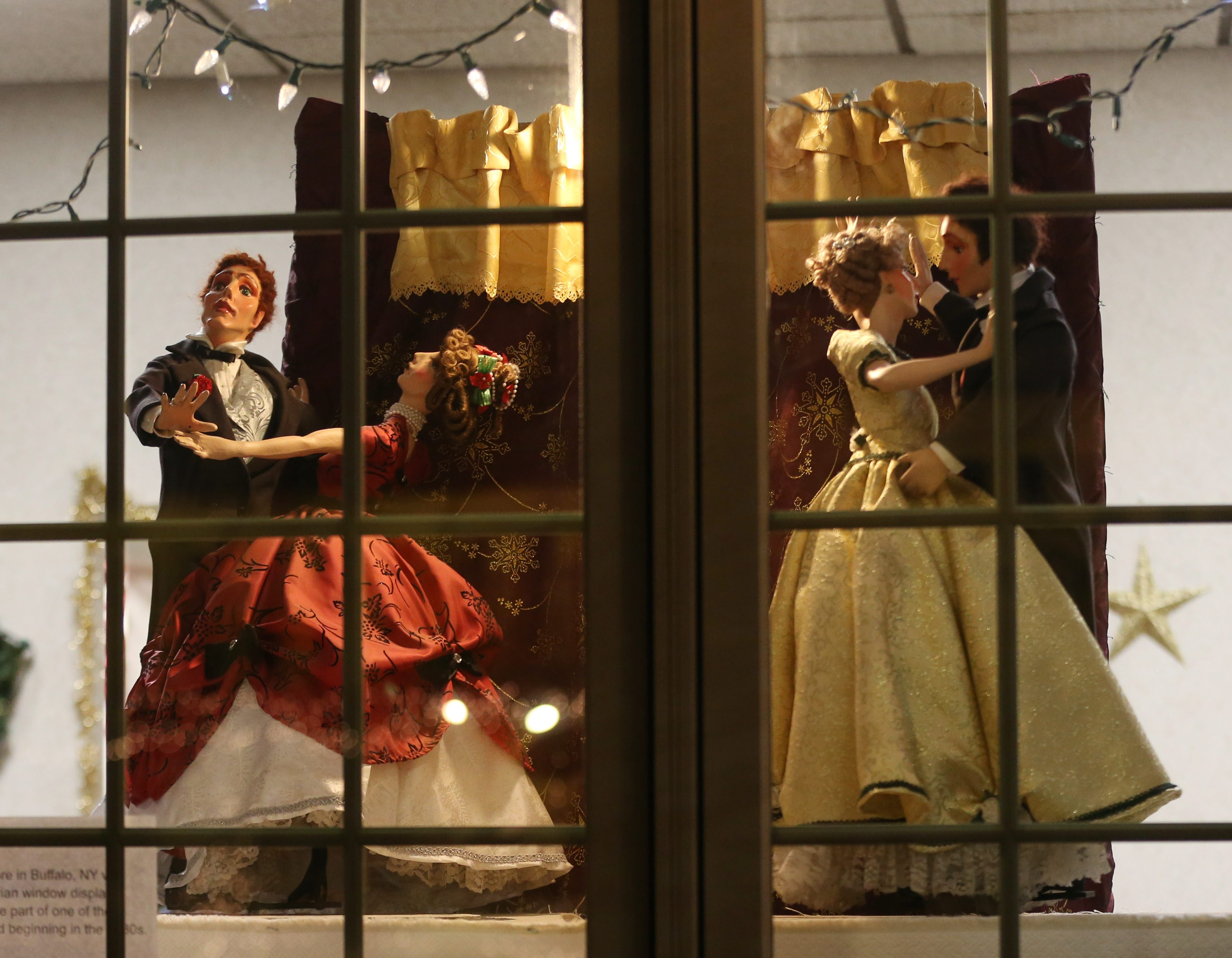 The shops on Central Avenue in the Village of Lancaster decorate their windows for Christmas.   This vintage animated display is at General Dentistry. (Sharon Cantillon/Buffalo News)