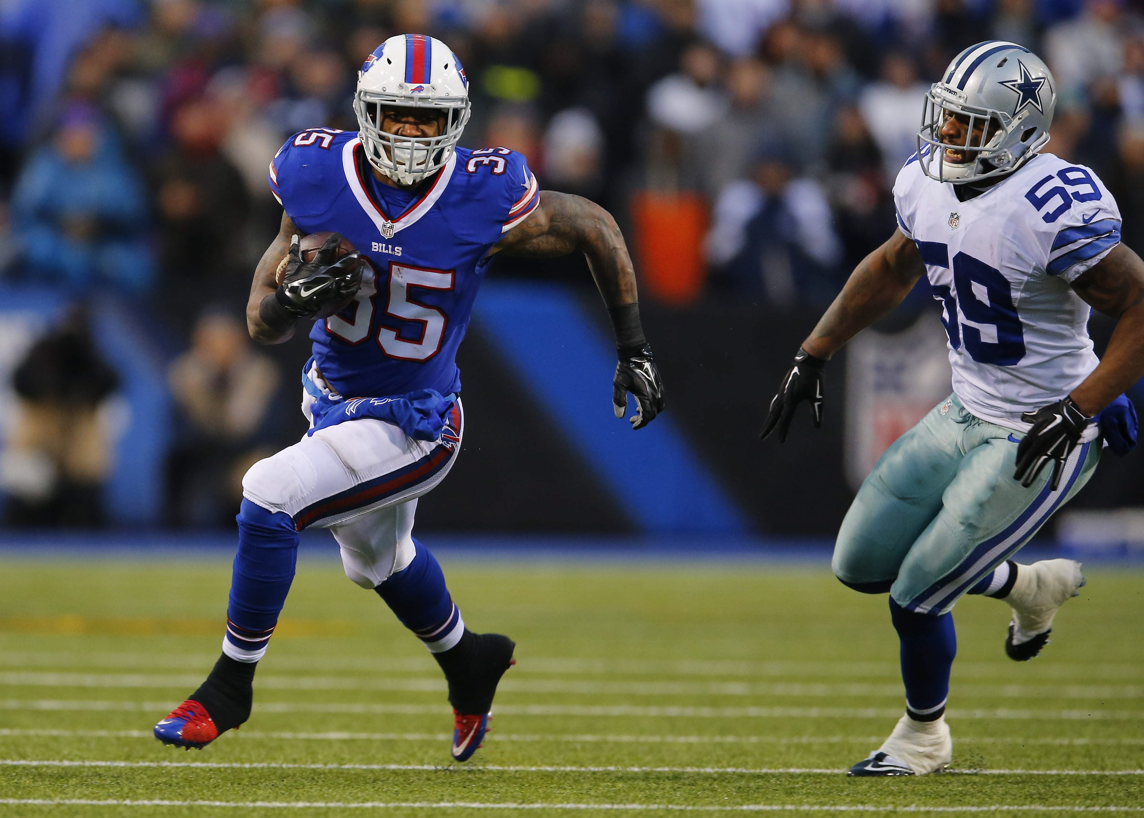 Pleasant surprise Mike Gillislee beats the Cowboys' Anthony Hitchens to score in the fourth quarter.  (Mark Mulville/Buffalo News)