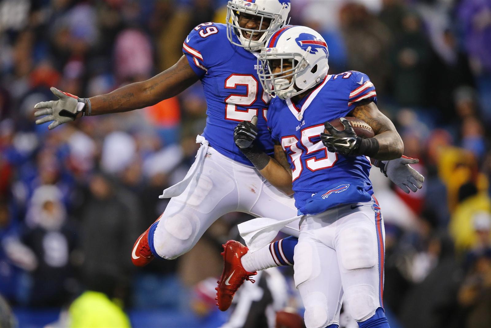 Mike Gillislee (35) and Karlos Williams celebrate Gillislee's touchdown run. (Mark Mulville/Buffalo News)