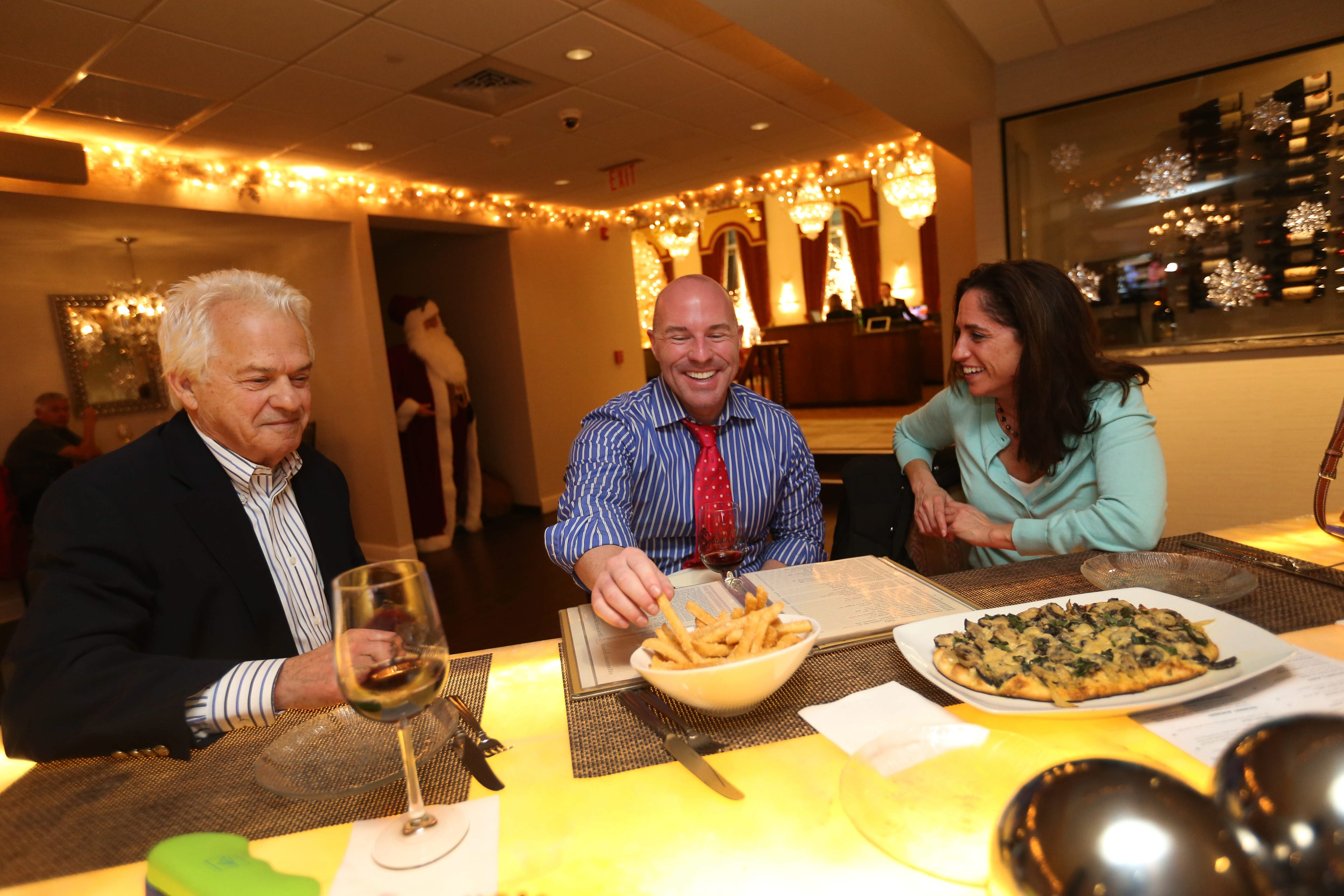 The Chandelier Bar at Salvatore's Italian Garden is newly revamped and is a destination in itself. Hanging out from left are Jerry Meyers of Williamsville, Anthony Pandolfi of Lancaster and Amy Pohlman of Amherst.  Photo taken, Wednesday, Nov. 18, 2015.  (Sharon Cantillon/Buffalo News)