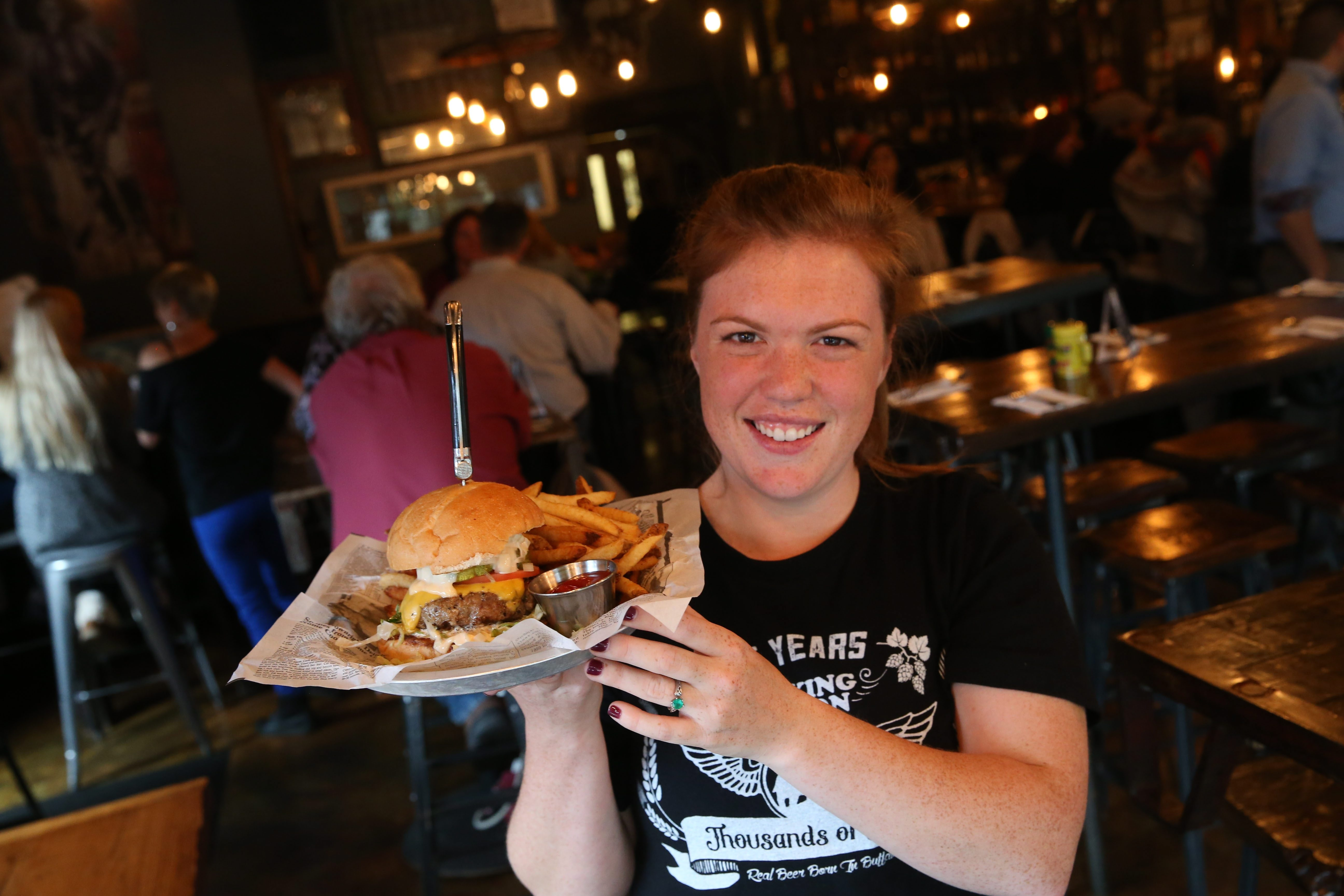 Allen Burger Venture at 175 Allen St. is one of Andrew Galarneau's favorite new restaurants in 2015. Server Sarah Francis presents the All-American burger.  (Sharon Cantillon/Buffalo News)