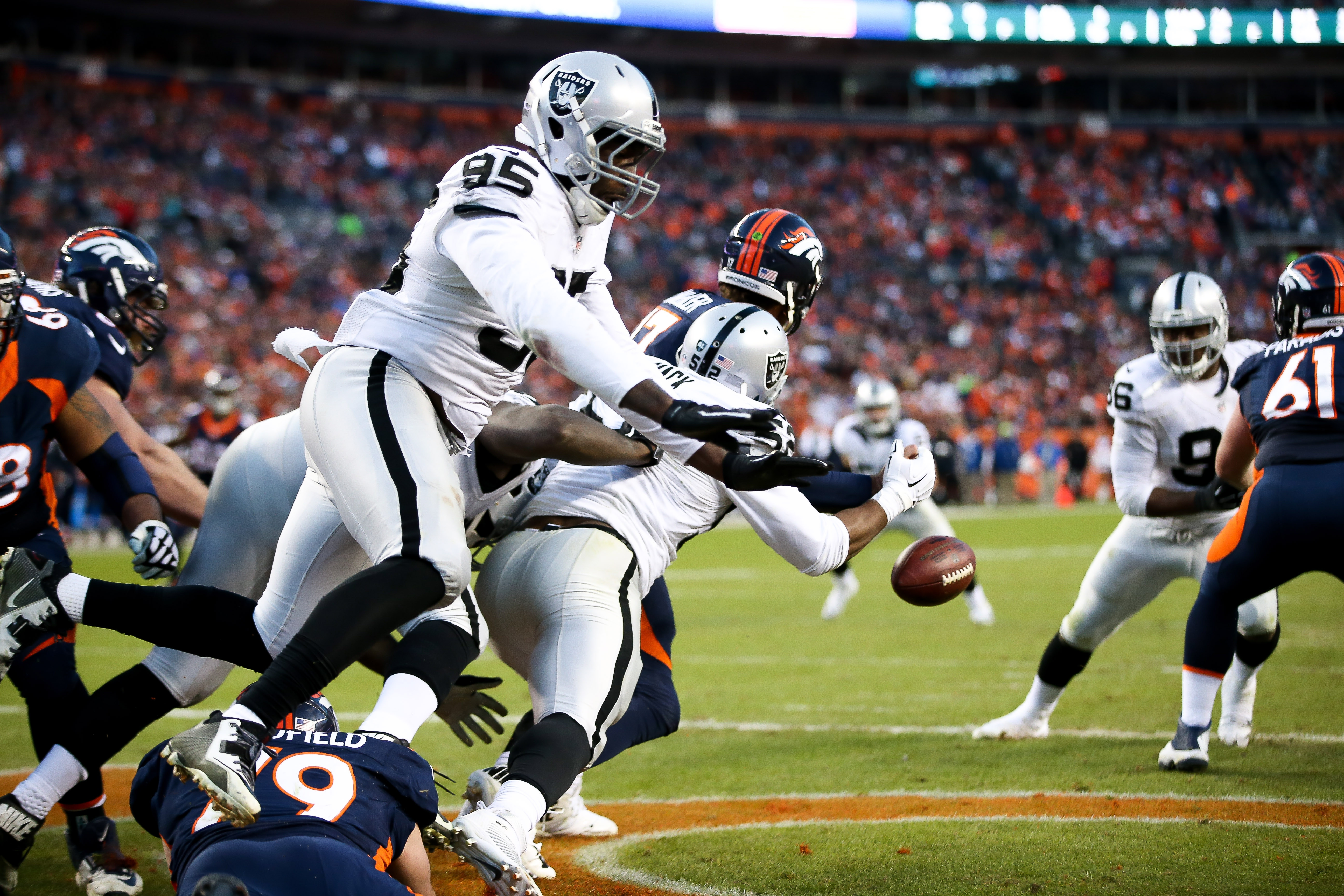 Broncos quarterback Brock Osweiler is stripped by former UB and current Raiders linebacker Khalil Mack resulting in a safety for Oakland.