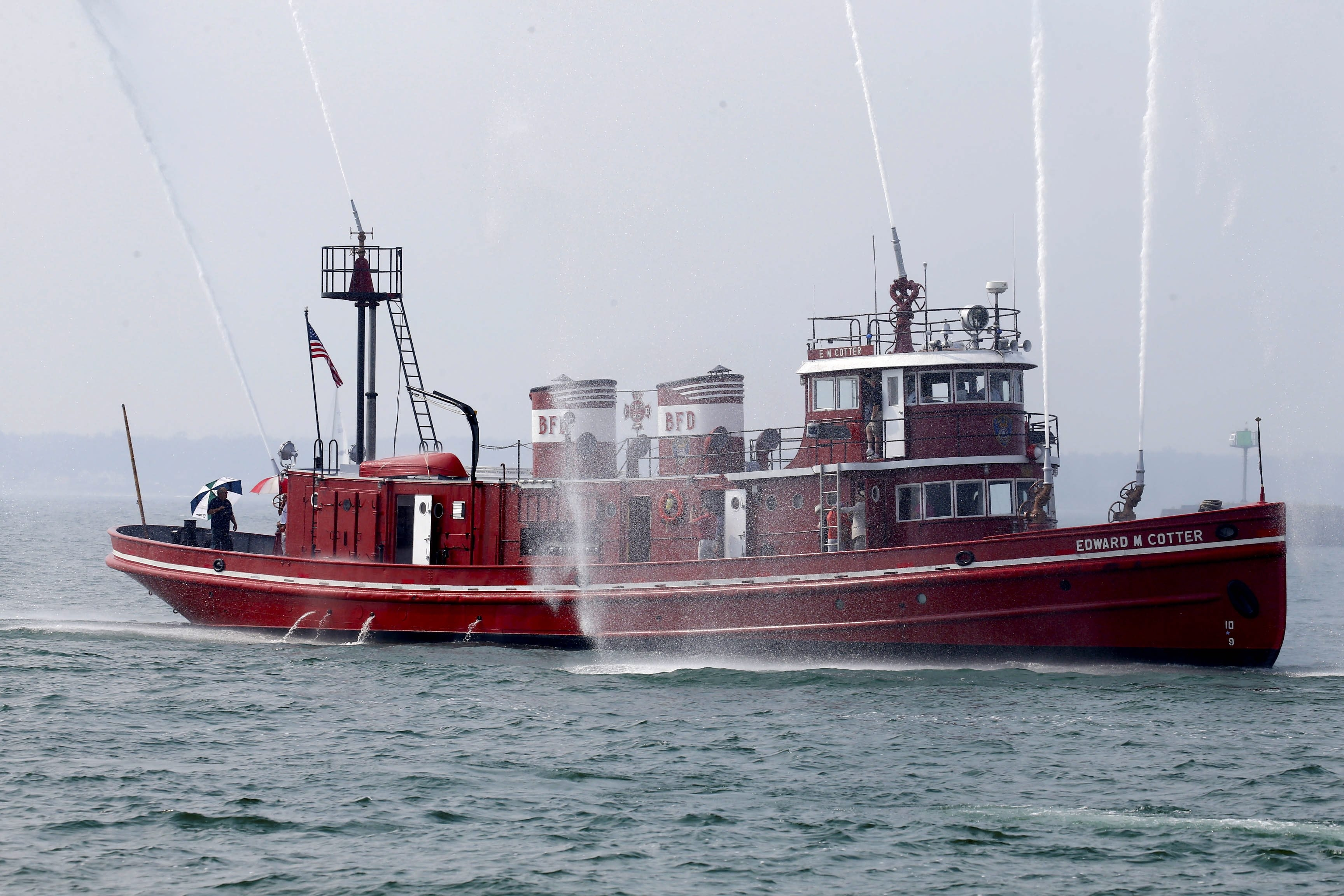 The Edward M. Cotter fire boat giving a ceremonial welcome to an arriving vessel Sept. 2, 2015. (Robert Kirkham/Buffalo News)