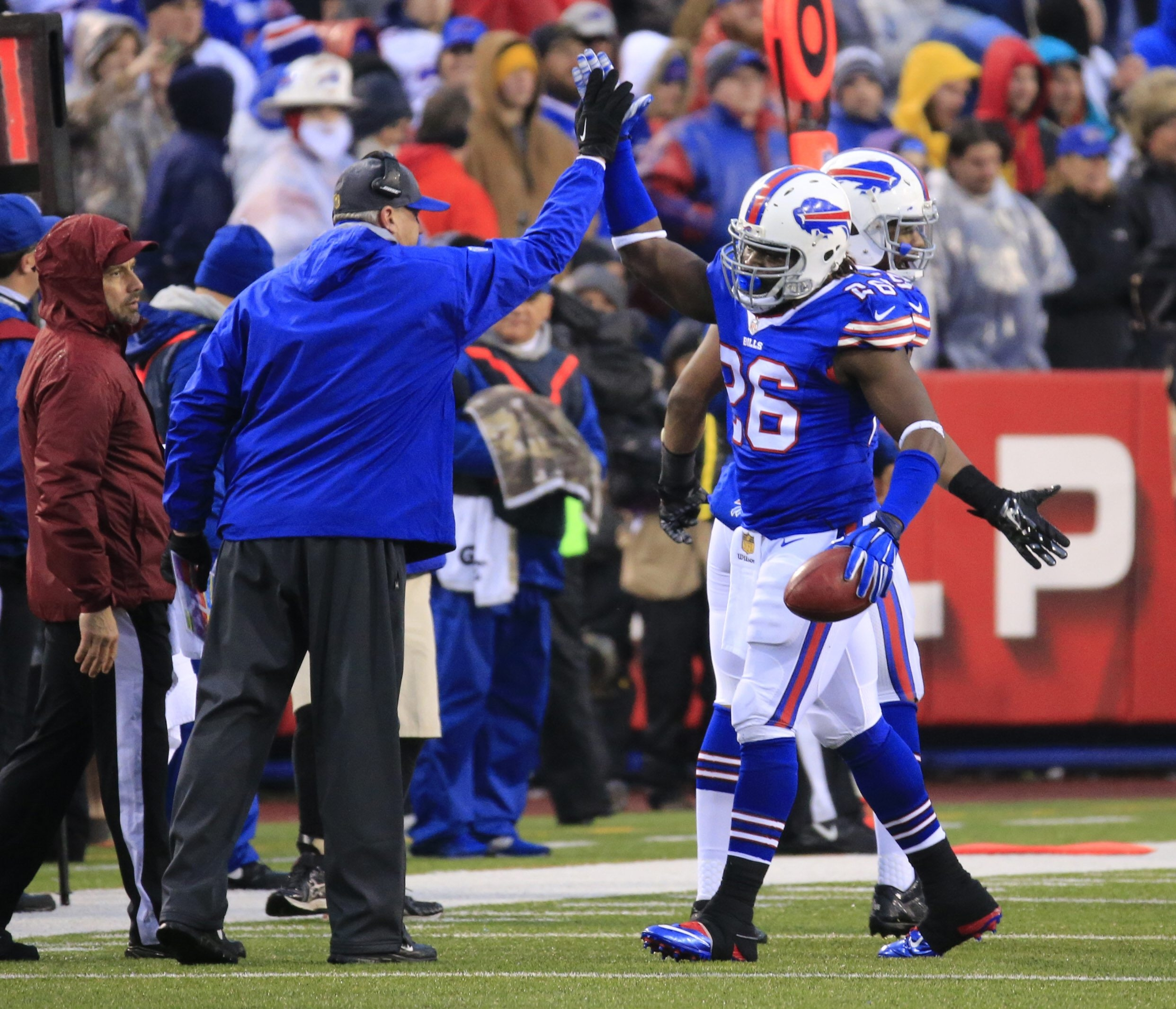 Bills running back Mike Gillislee gets a high five from coach Rex Ryan after running for a 50-yard touchdown against the Cowboys in the fourth quarter.