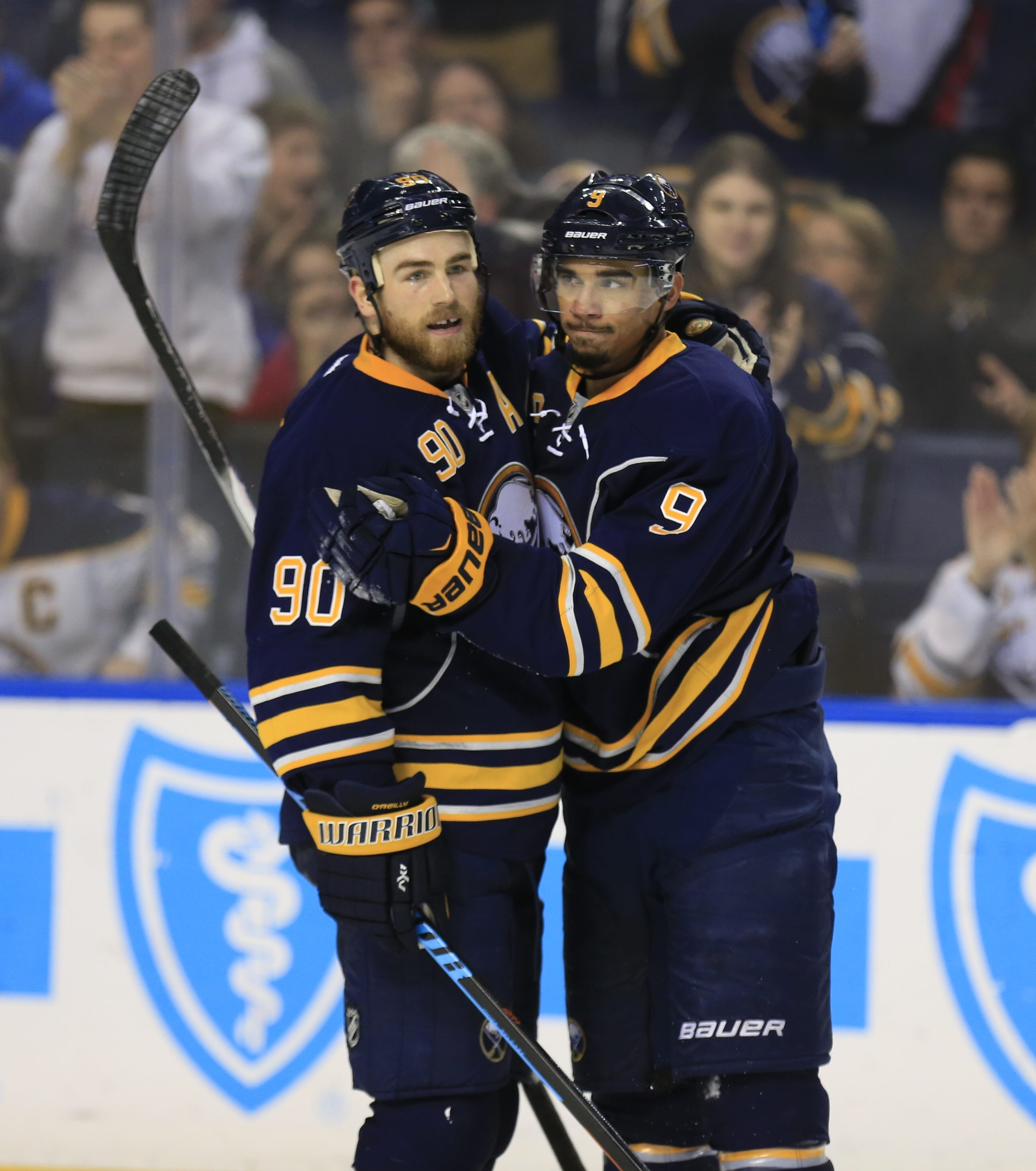Bufalo Sabre Evander Kane celebrates a empty net goal with Ryan O'Reilly against the Arizona Coyotes during third period action at the First Niagara Center on Friday, Dec. 4, 2015. (Harry Scull Jr./Buffalo News)