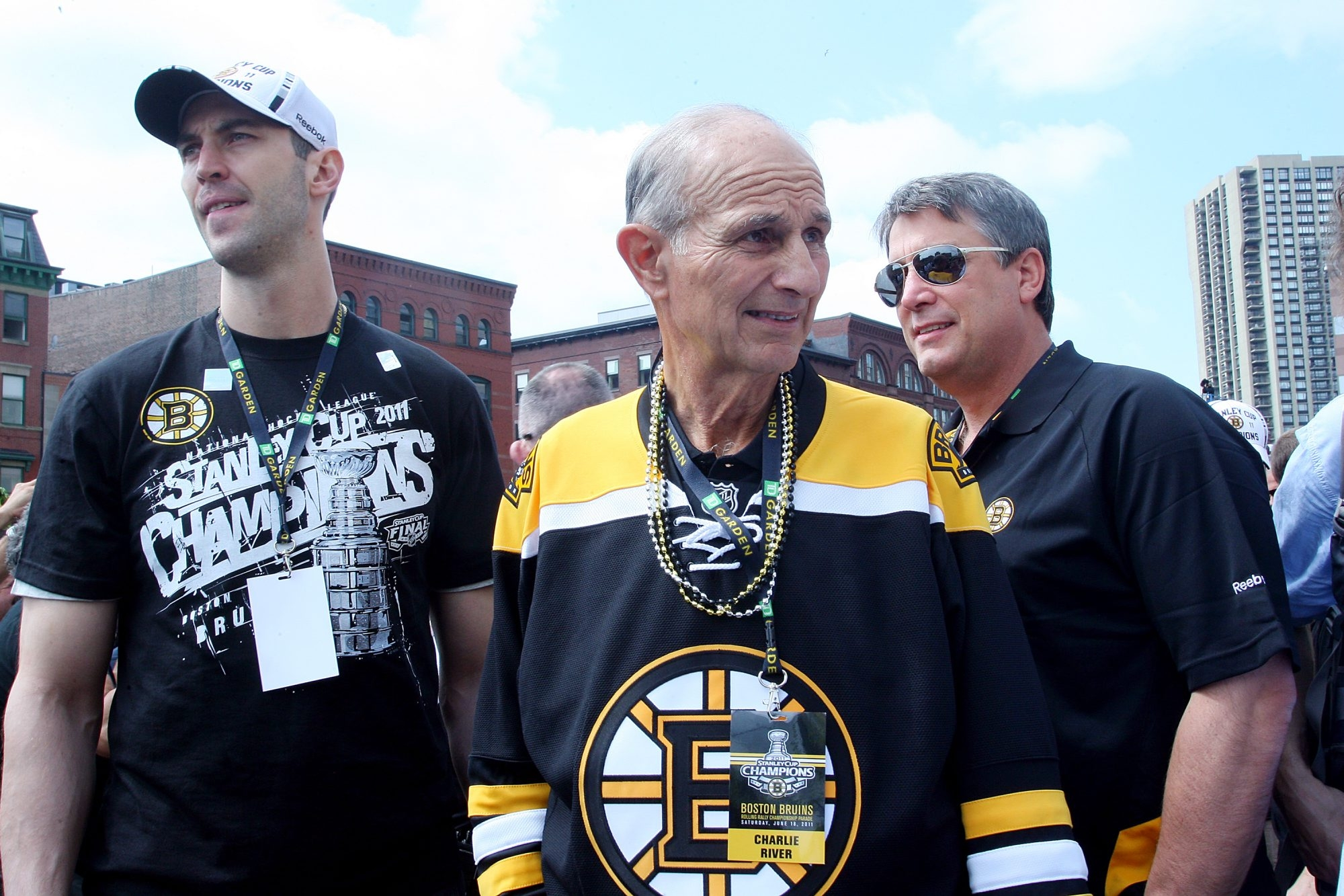 Boston Bruins owner Jeremy Jacobs, center, added a hockey championship to the city's recent sports success with a Stanley Cup win in 2011.
