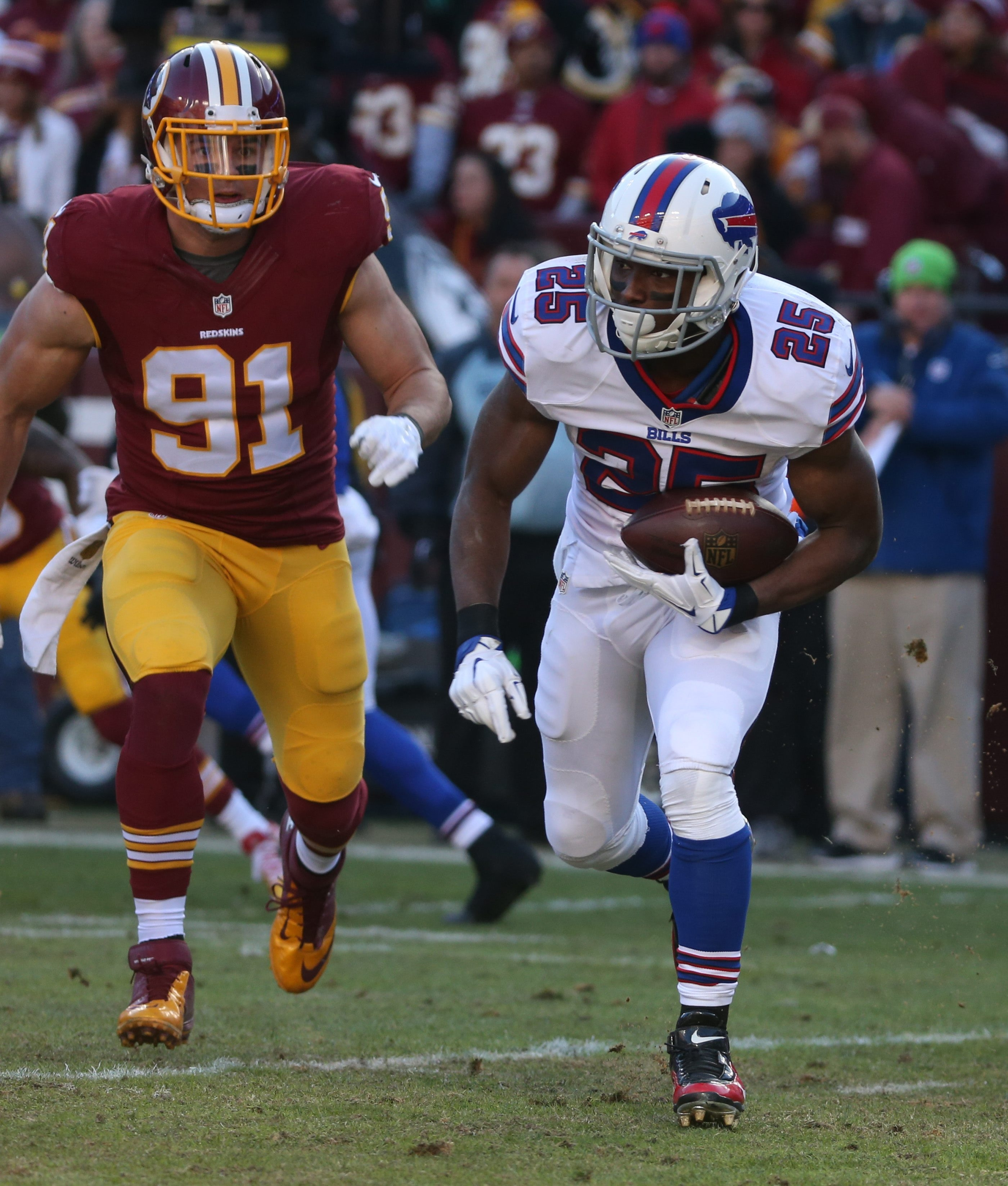 2 lie ncut Buffalo Bills running back LeSean McCoy (25) beats Washington Redskins outside linebacker Ryan Kerrigan (91) in the second quarter at Fed Ex field in Landover, Md on Sunday, Dec. 20, 2015.  (James P. McCoy/ Buffalo News)