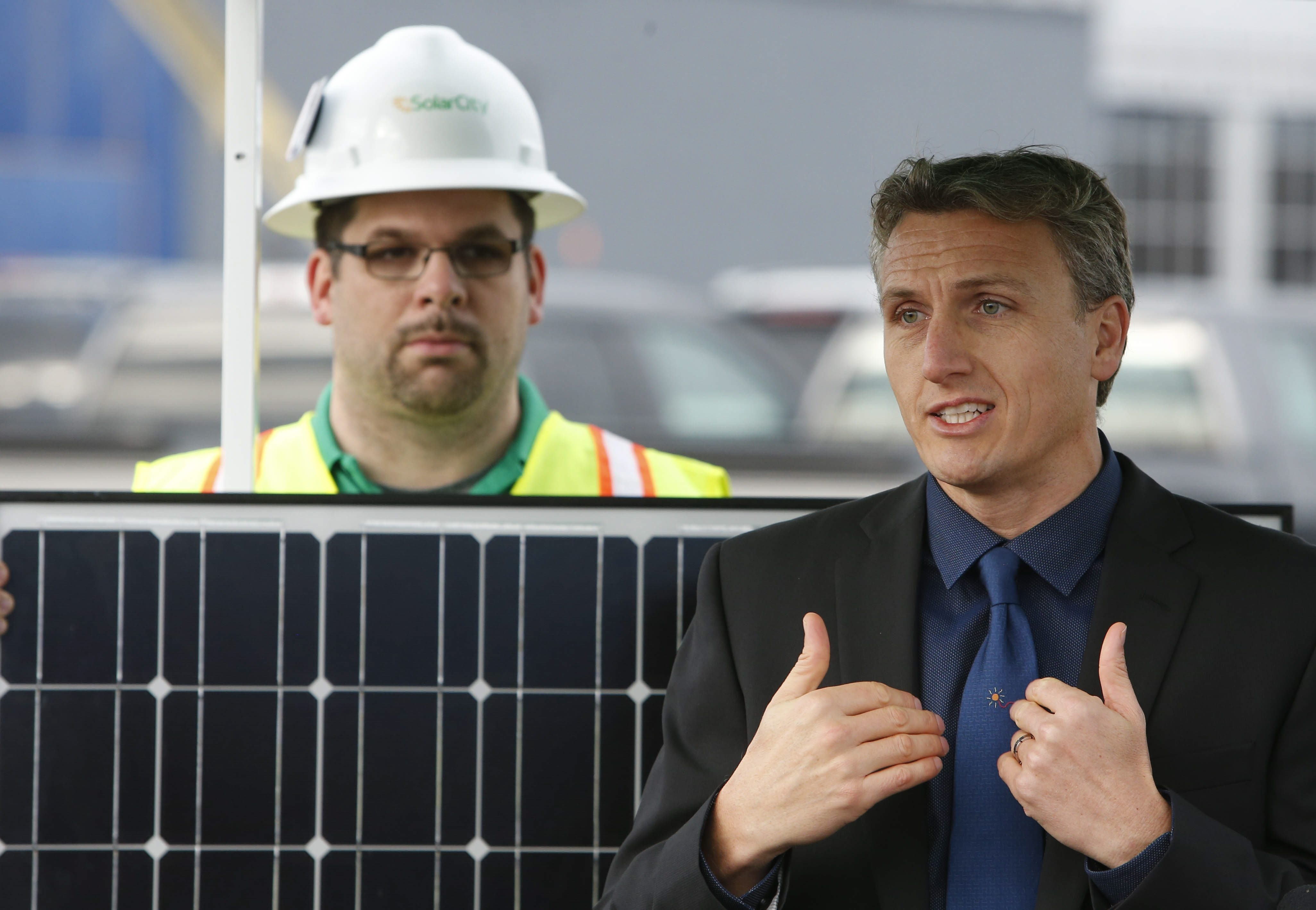Solar City CEO Lyndon Rive, right, talks about the effects of the recent extension of the solar energy tax credit during a press conference with U.S. Senator Charles Schumer, not pictured, outside the Solar City facility under construction at RiverBend, Tuesday, Dec. 22, 2015.  (Derek Gee/Buffalo News)