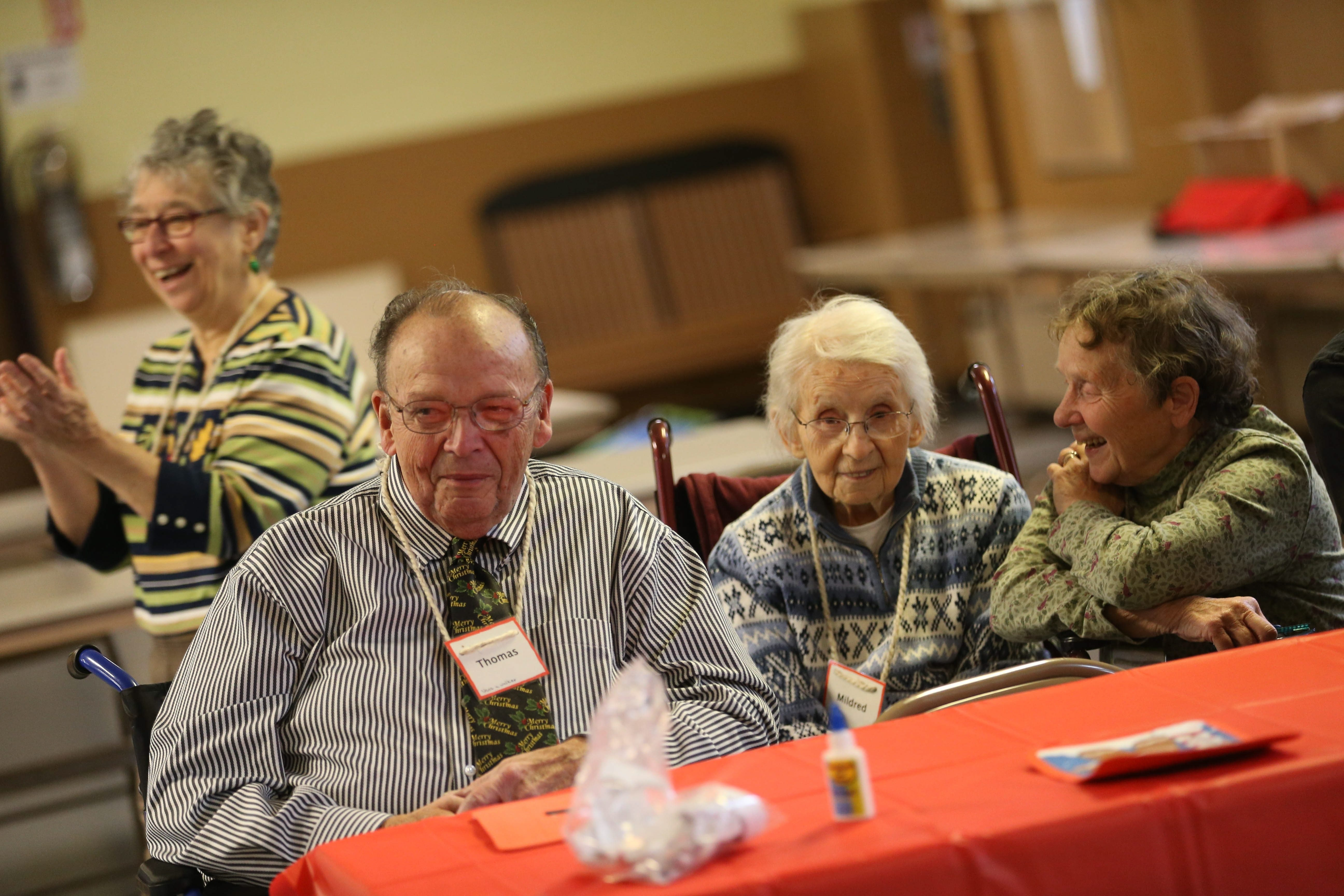 Trinity Old Lutheran Church on Sheridan Drive in Amherst provides a respite one day a month for caregivers giving them time while trained volunteers care for their loved ones. The group  plays the word game, hangman, Wednesday, Dec. 2, 2015.  Playing from left are Thomas Spankle, Mildred Toner and volunteer Elaine Geschwender. (Sharon Cantillon/Buffalo News)