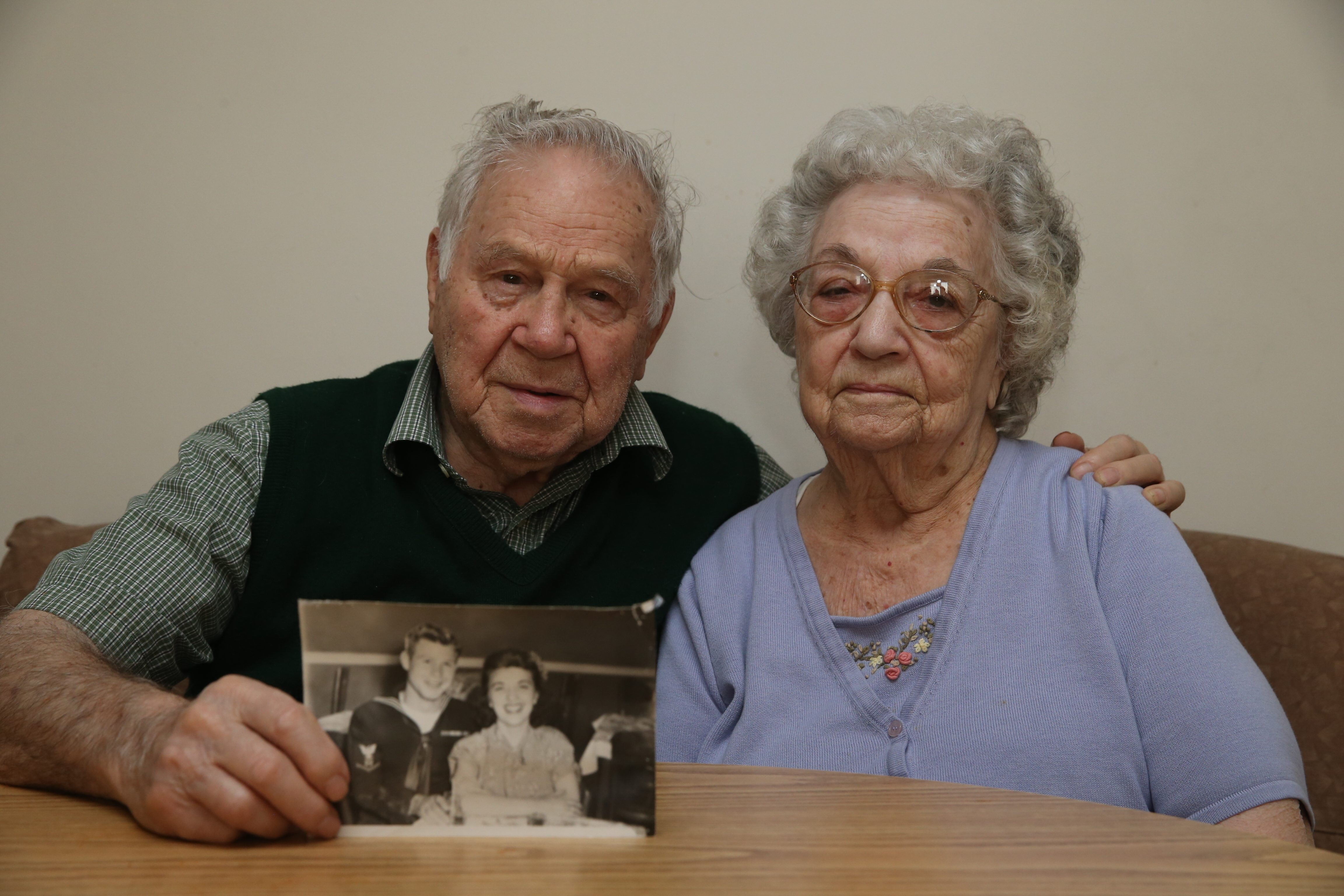 Photo of Eugene Piccione, while he was still in the Navy, and his bride-to-be, Carmela Guzzino, brings back mem- ories for the couple, who have been married for 69 years.