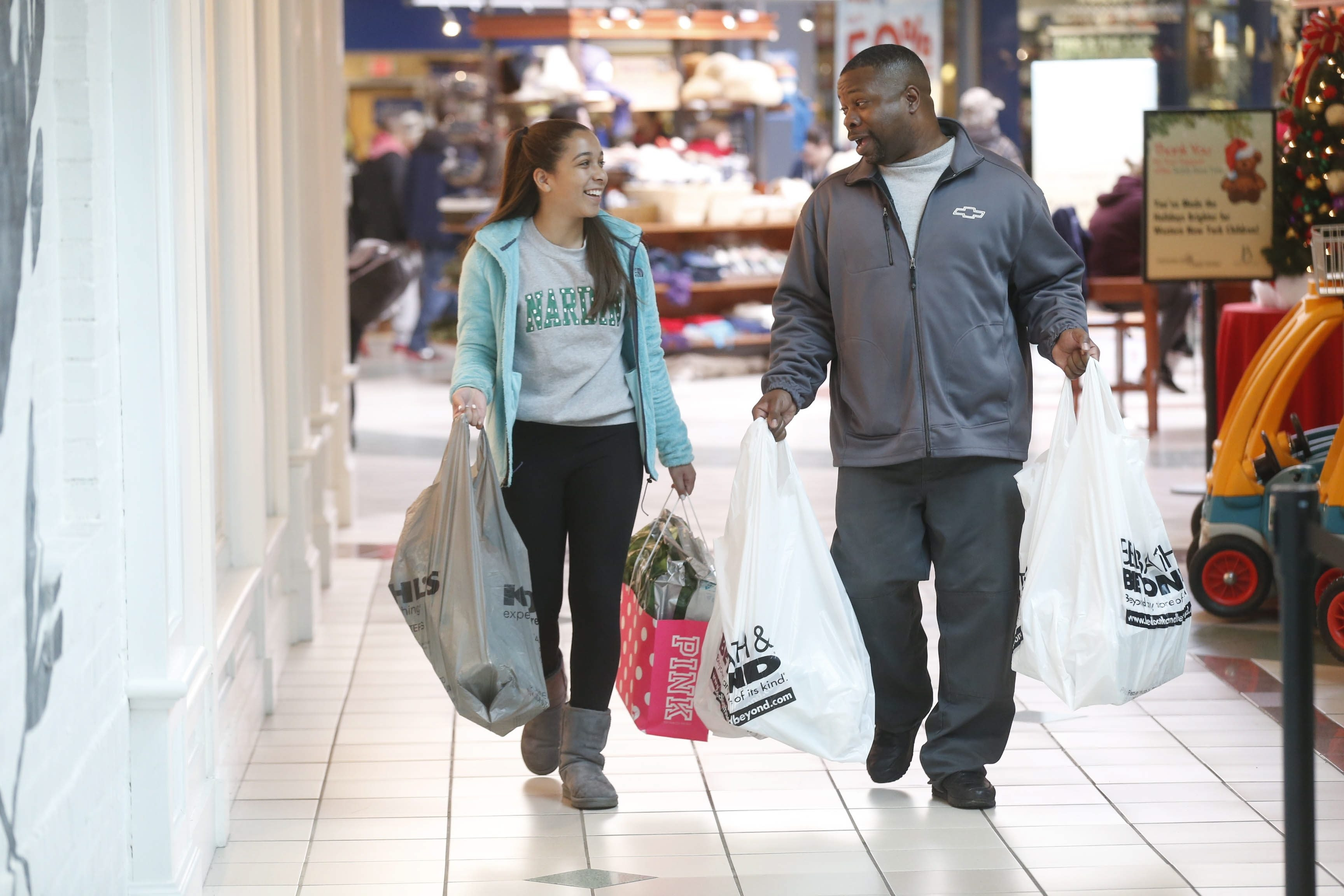 "David Hartley, of Amherst, happy to get advice from daughter Alyssa, 13, shops with her at Boul- evard Mall. He decided not to get a sweater for his wife when told, ""She doesn't wear that, Dad."""