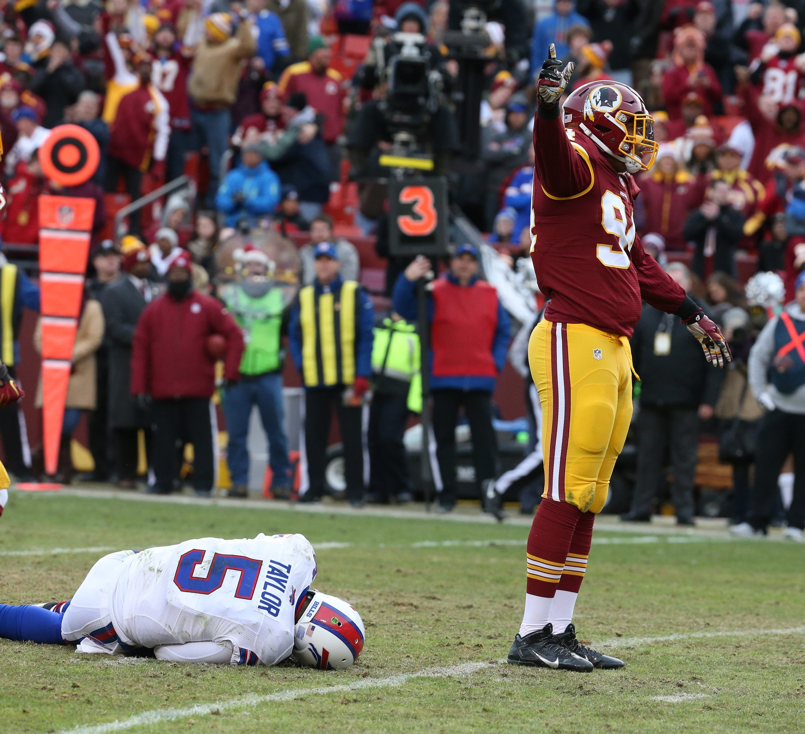 Bills quarterback Tyrod Taylor lies on the turf at FedEx Field after being sacked by Redskins linebacker Preston Smith during the fourth quarter.