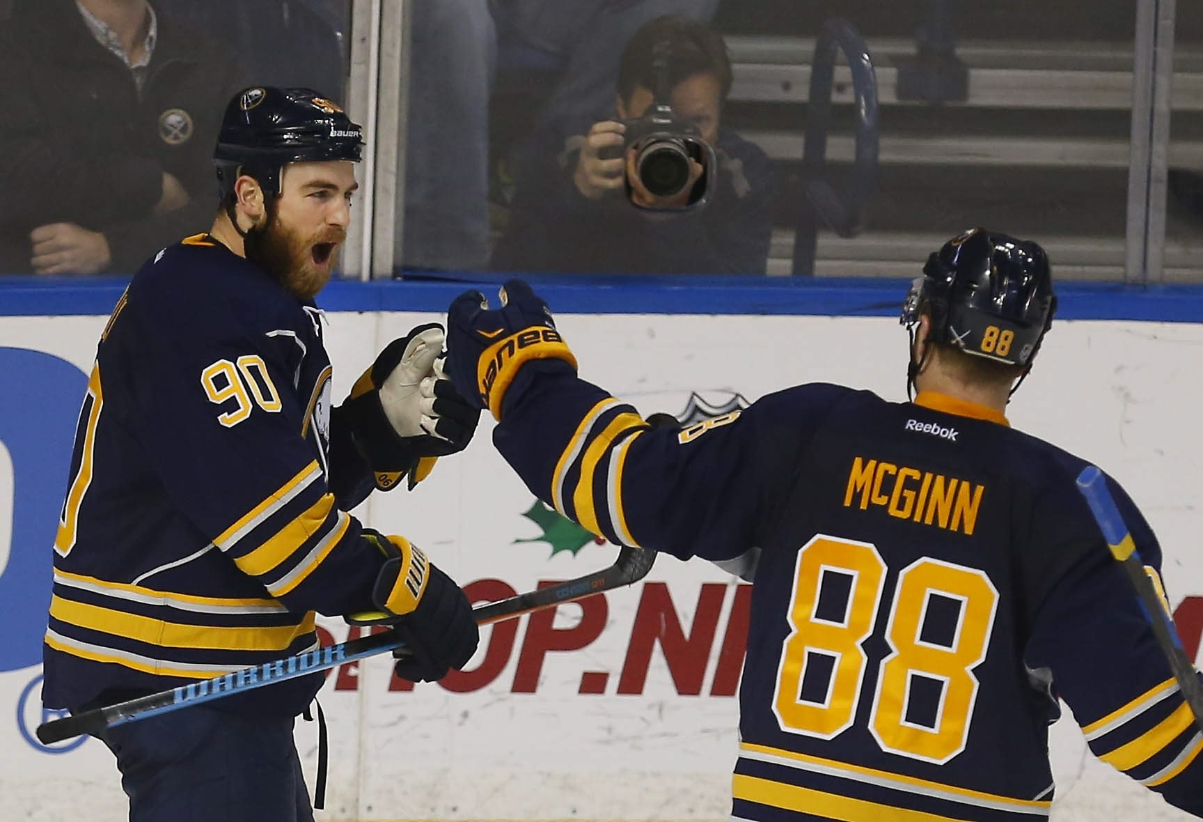 Ryan O'Reilly celebrates with Jamie McGinn after scoring to give the Sabres a third-period lead over Chicago. The Blackhawks rallied to win in a shootout.