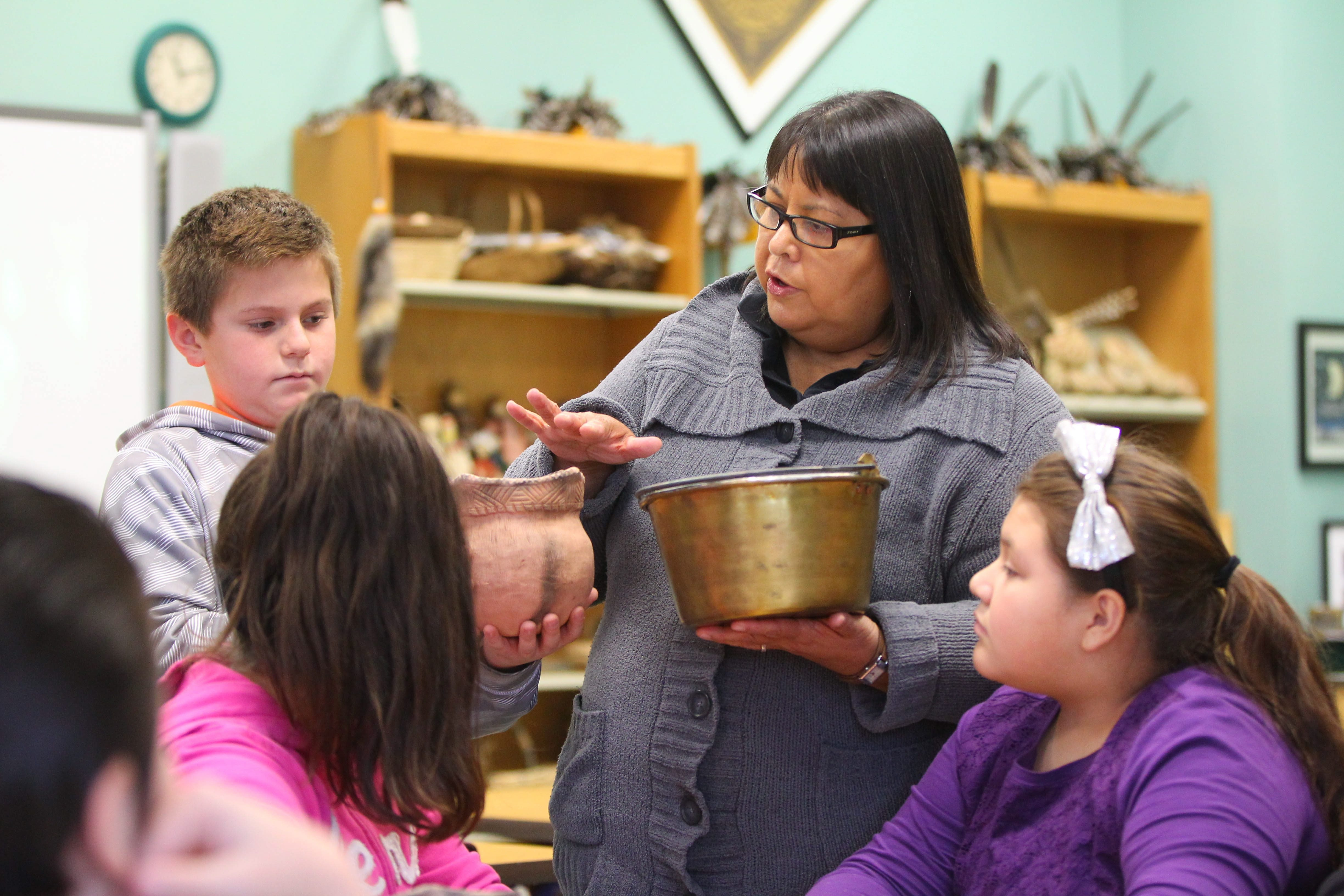 Joanne Weinholtz works with 5th graders in the culture room at the Tuscarora Indian School on the Tuscarora Reservation Monday, December 7, 2015.  (Mark Mulville/Buffalo News)