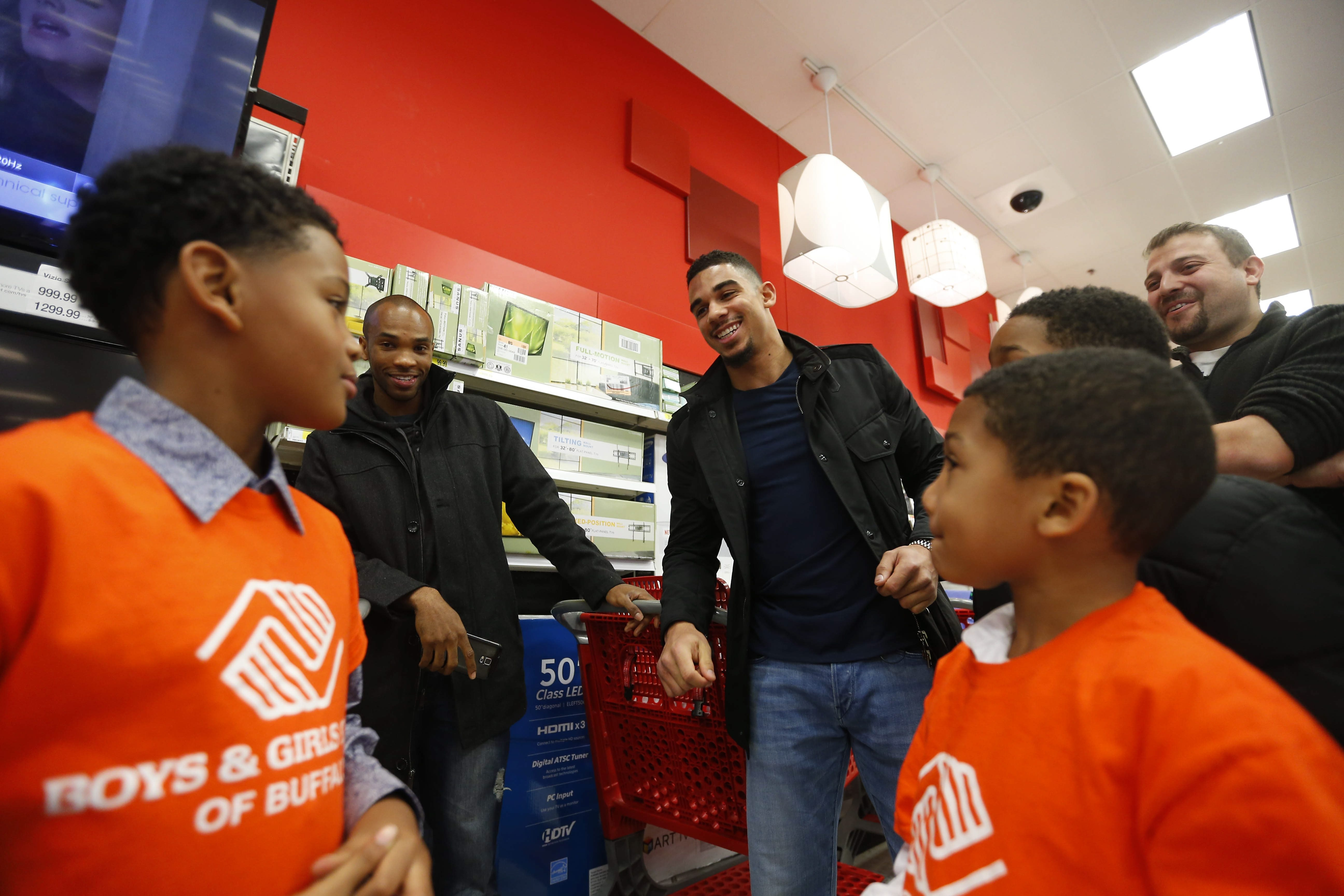 Evander Kane, center, thrills kids from the Boys and Girls Club.