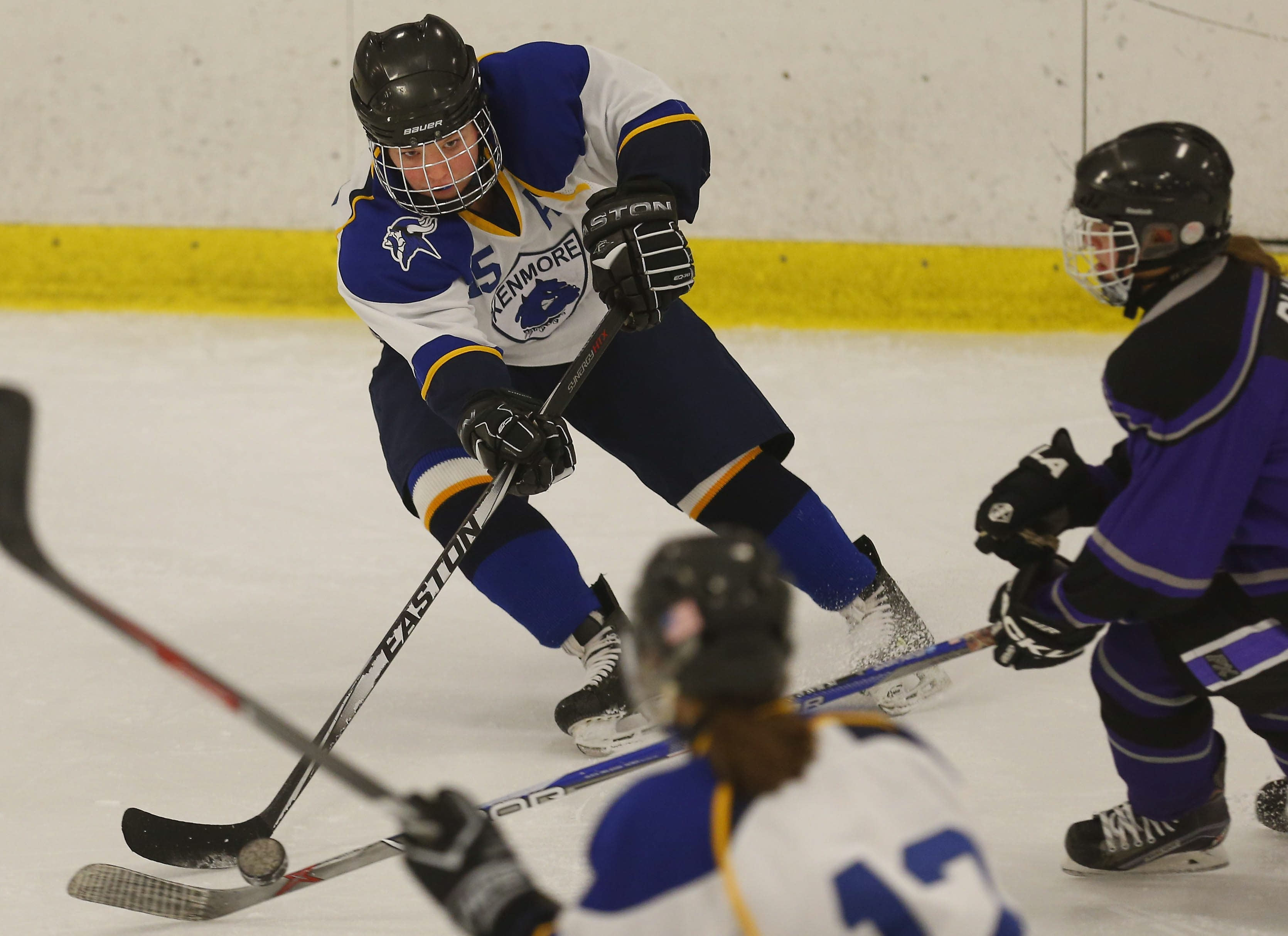 Kenmore/Grand Island's Grace Simmons clears the puck during Thursday's game against Monsignor Martin at the North Buffalo Ice Rink. Monsignor Martin won, 4-1.