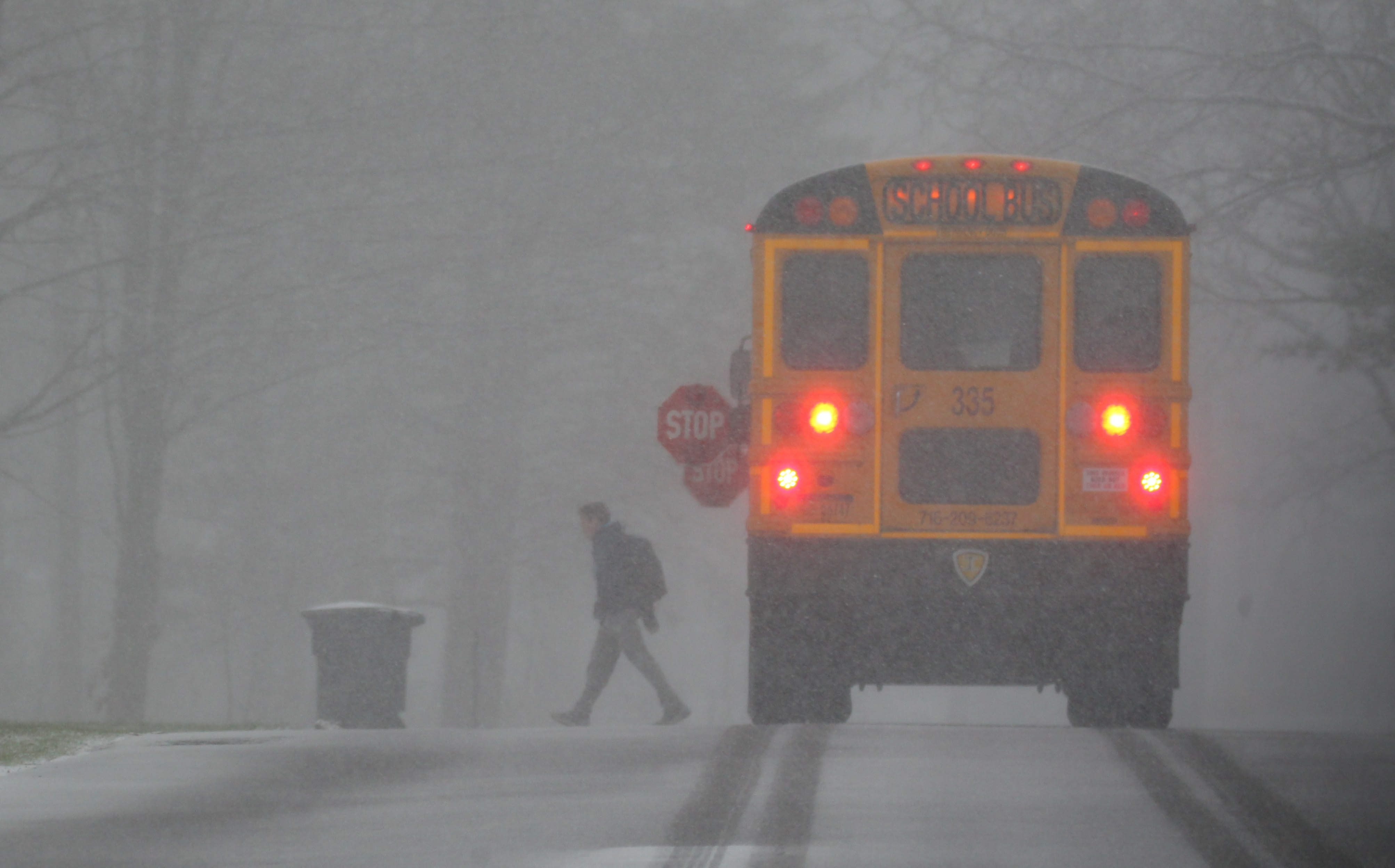 A school bus drops off a child in the snow at their home in Orchard Park Friday, December 18, 2015.  (Mark Mulville/Buffalo News)