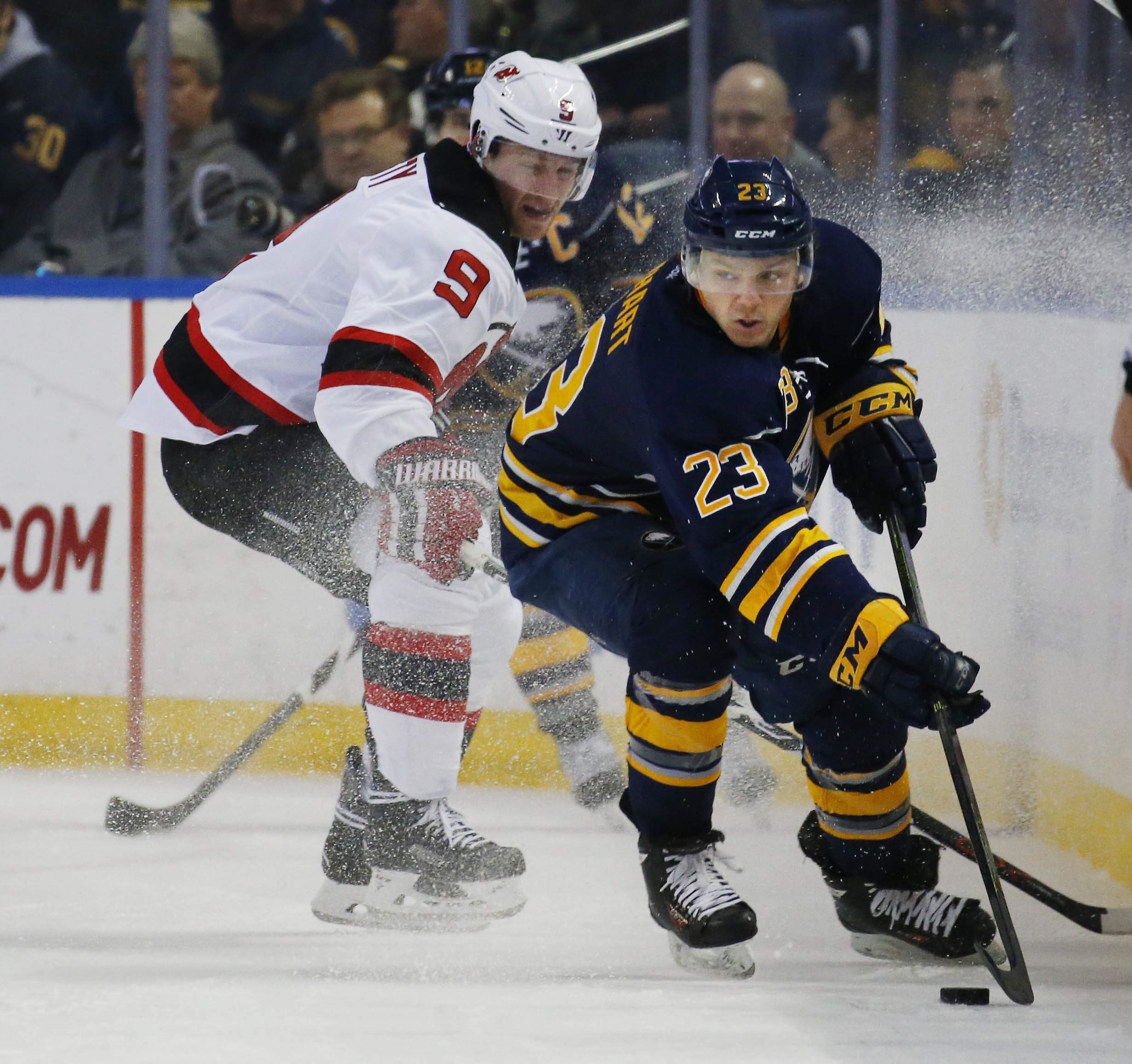 Buffalo's Sam Reinhart takes the puck from the Devils' Jiri Tlusty in the second period of the Sabres' 2-0 loss Tuesday.
