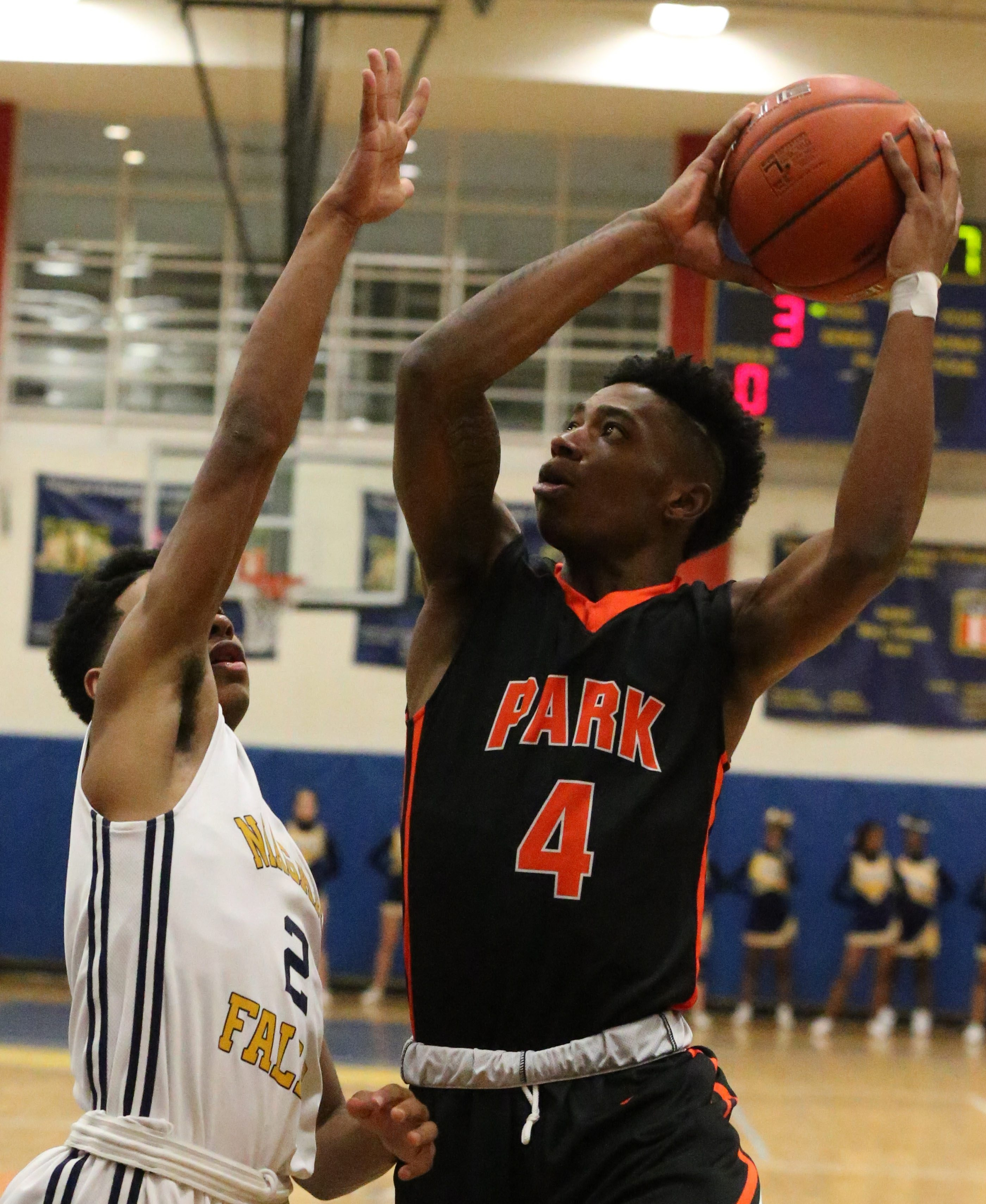 Park School's Kyle Harris scores two points during its win over Niagara Falls Saturday in the Cataract Classic.   High School player Qeyion Williams on Saturday.