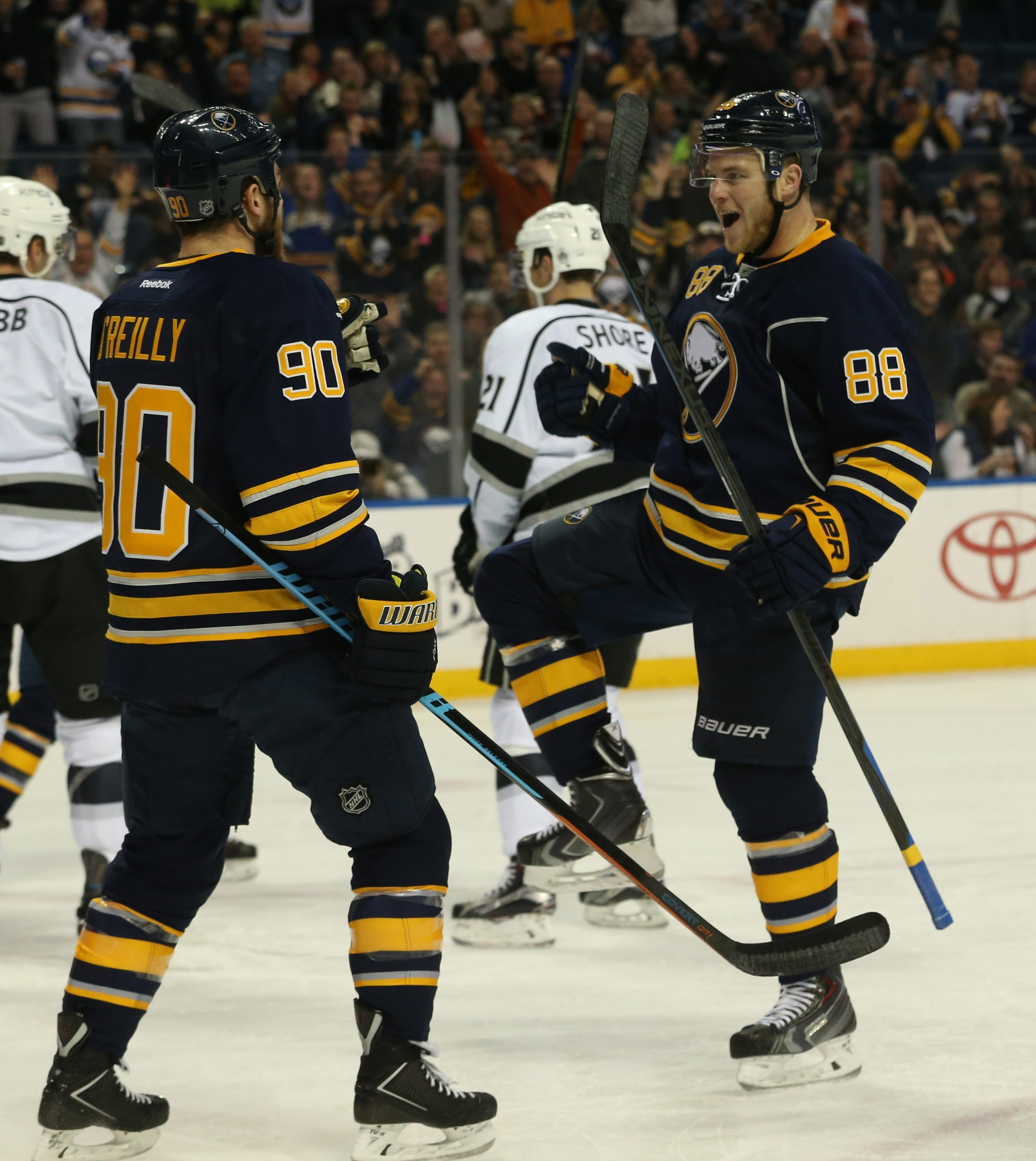 Jamie McGinn, right, celebrates his first-period power-play goal against the Kings with teammate Ryan O'Reilly.