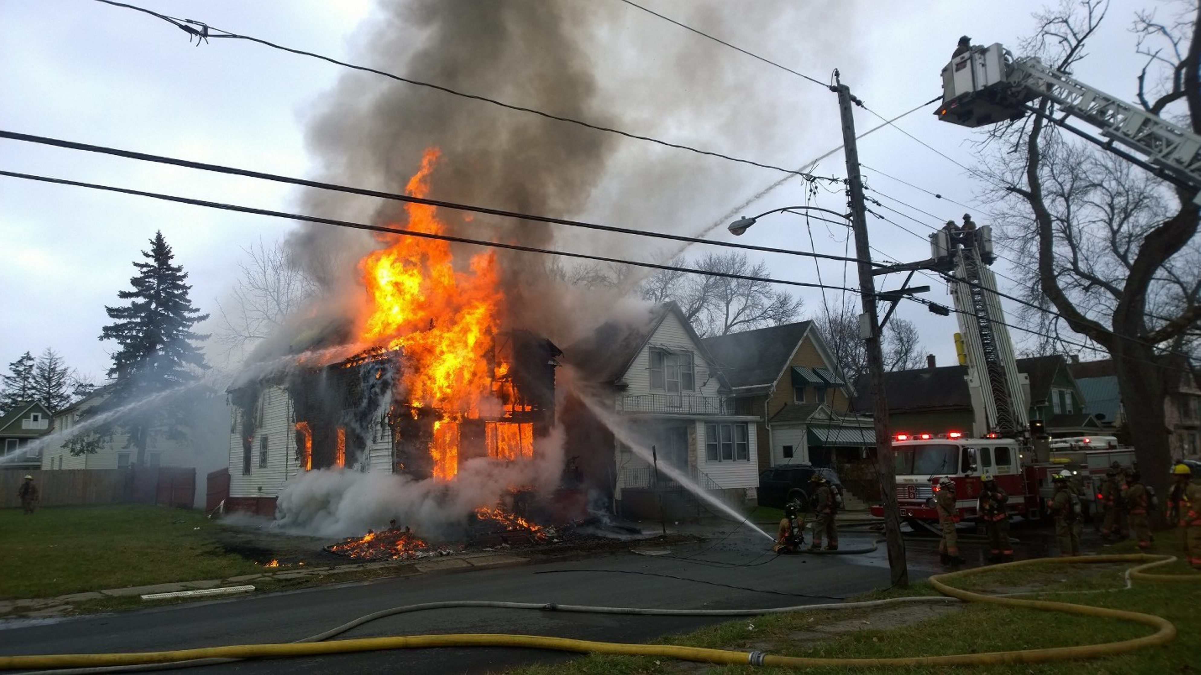 Firefighters at the scene of a Nevada Street fire Dec. 13. (David F. Kazmierczak/Special to The News)