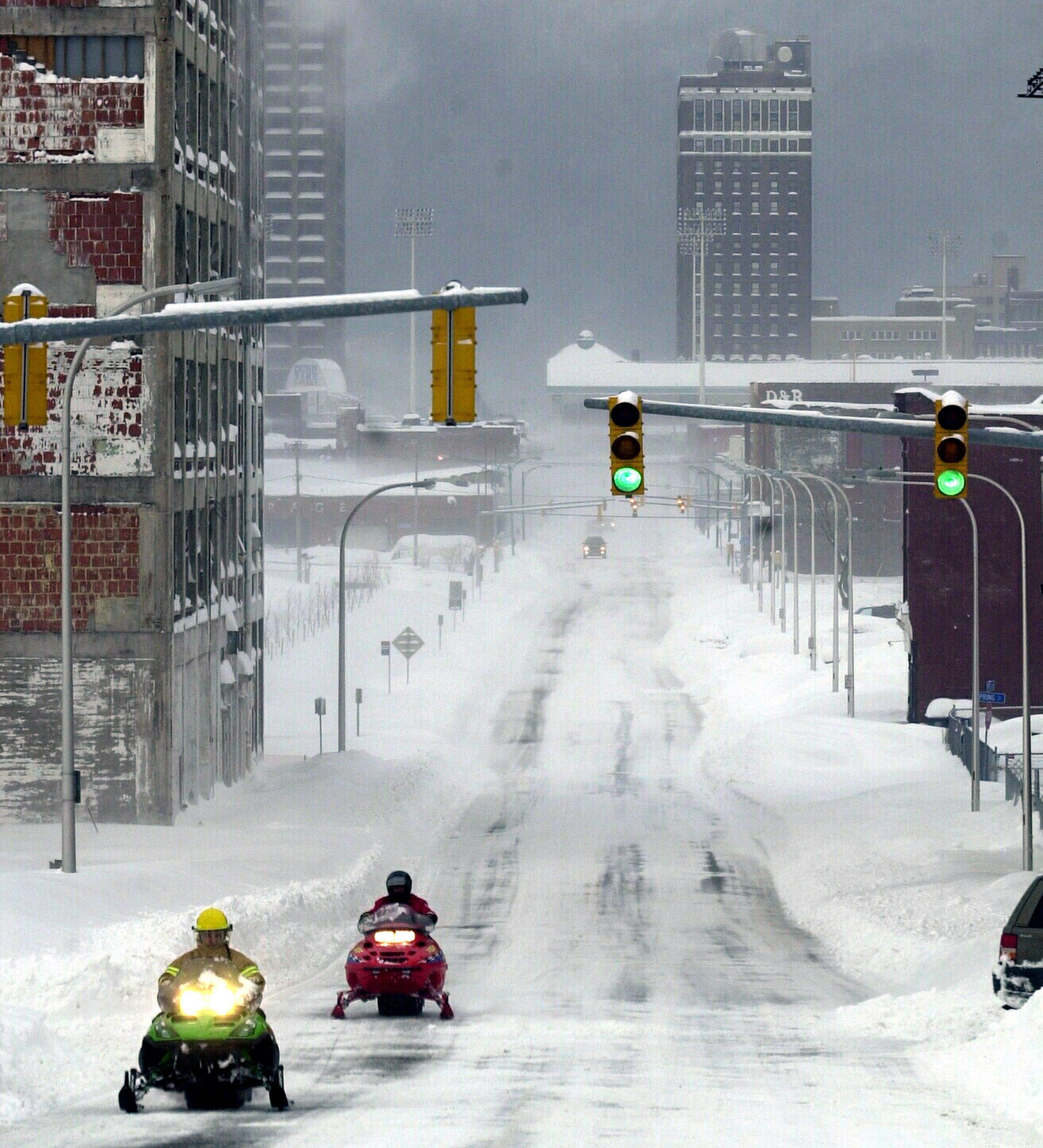 Snowmobiles, the preferred mode of transportation, head east on Seneca St. (Robert Kirkham/Buffalo News file photo)