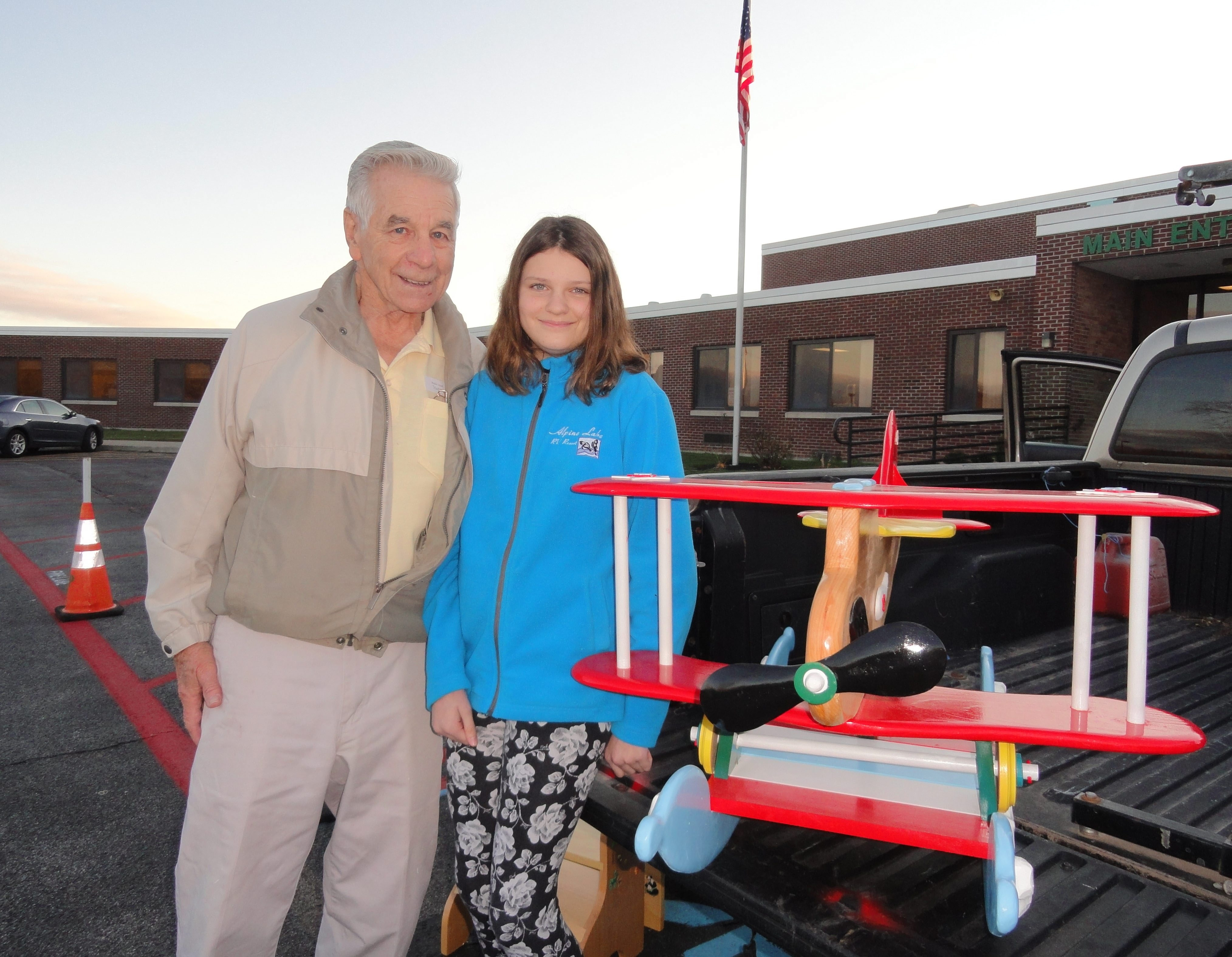 Ralph Skrlin of Wilson, and his granddaughter, Kristin Wilson, a Lewiston-Porter sixth-grader, made and donated rocking toys and step stools to be auctioned off in the schools.