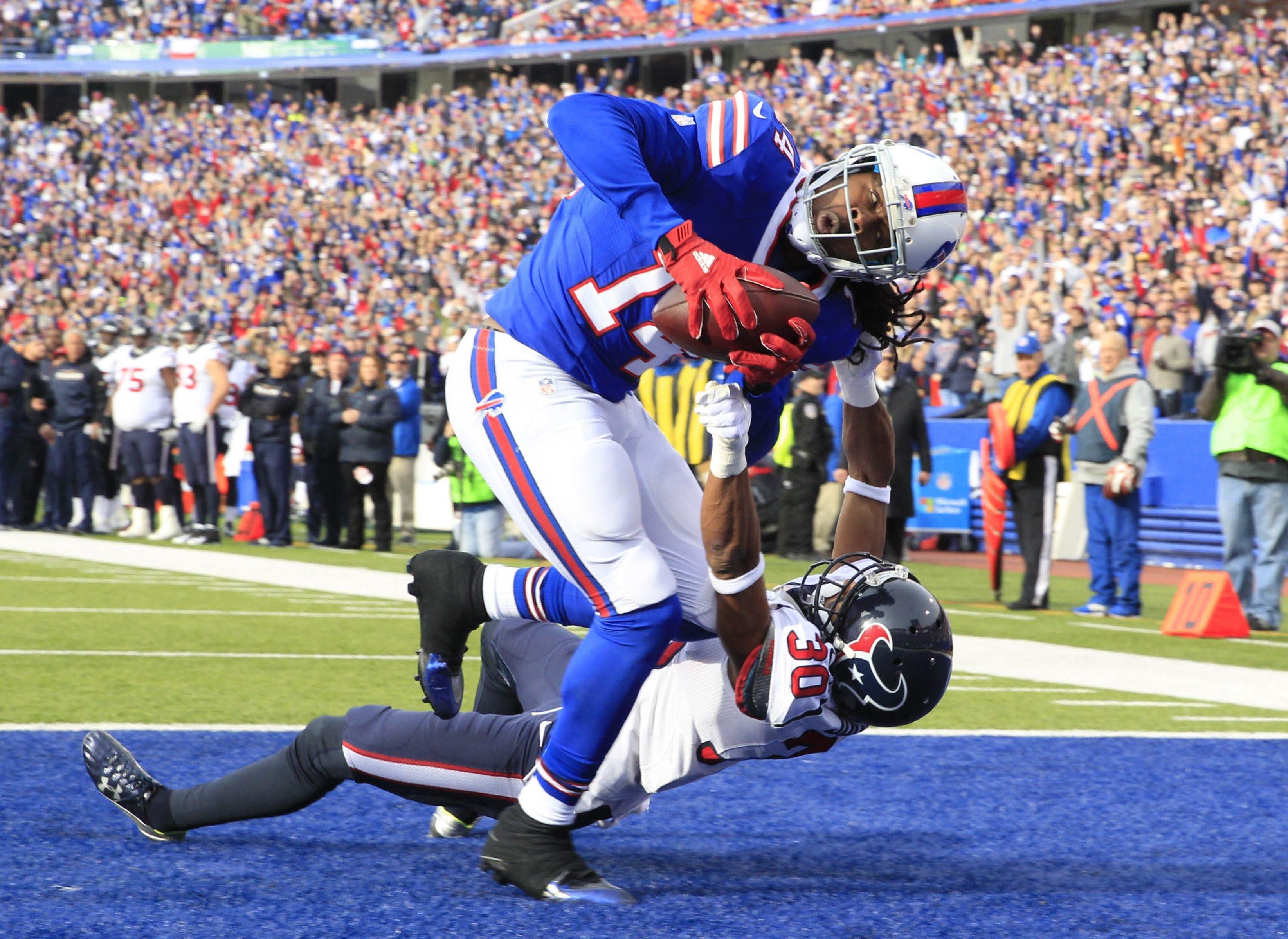 Bills receiver Sammy Watkins catches a 3-yard pass for a touchdown under pressure from Texans cornerback Kevin Johnson.